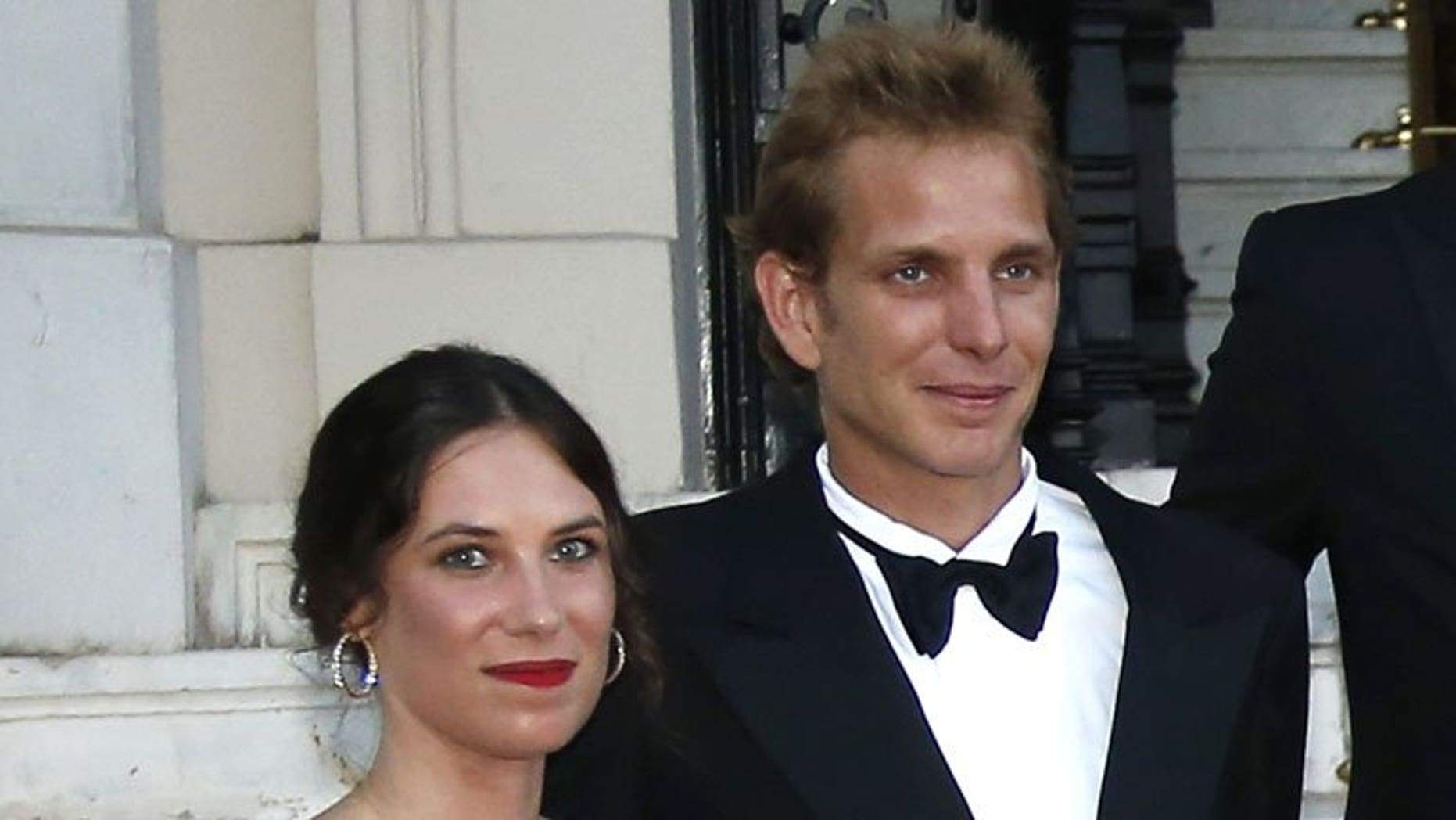"""Andrea Casiraghi, the son of Princess Caroline of Hanover, and his partner Tatiana Santo Domingo as they arrive to attend the """"Love Ball"""" in Monaco on July 27, 2013. Casiraghi, eldest son of Princess Caroline of Monaco, is to marry his Colombian girlfriend on August 31."""