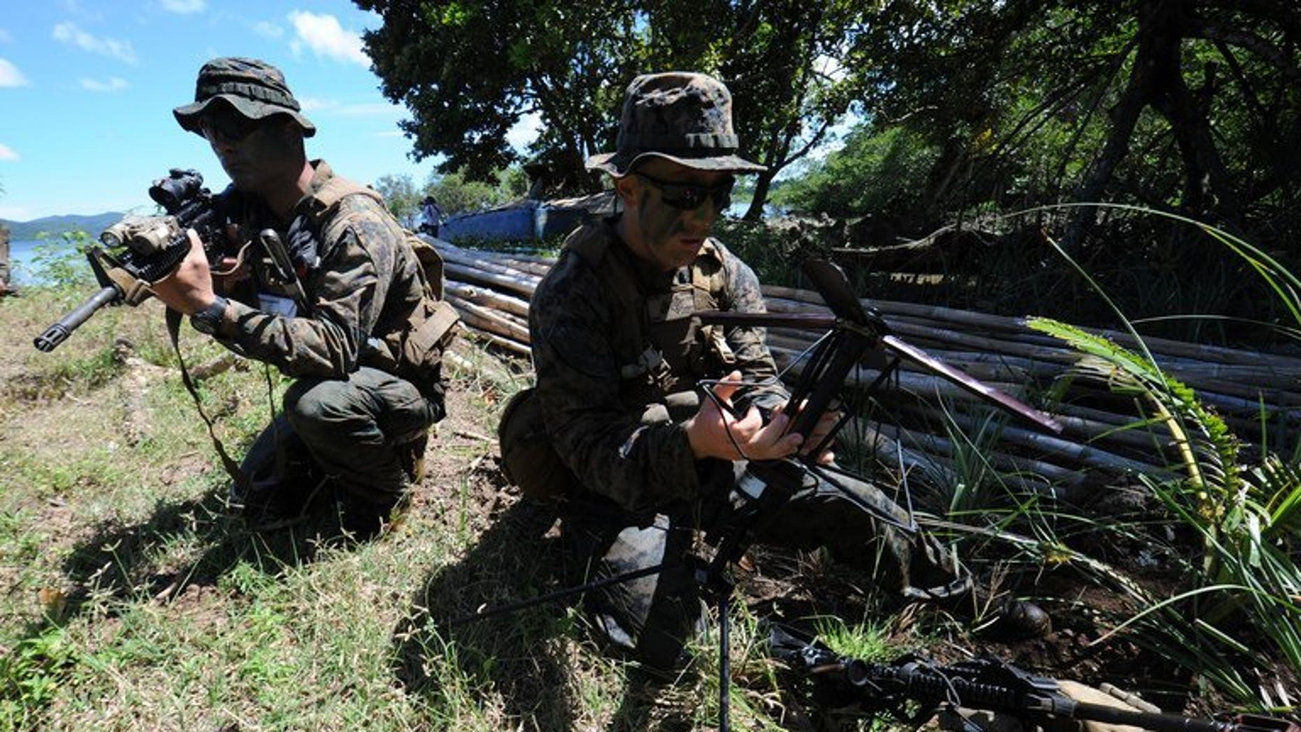 US soldiers prepare communication equipment during a joint exercise on the shore of Ulugan Bay, on Palawan island, on April 25, 2012. The Philippines and the United States have begun talks aimed at allowing a bigger US military presence on the soil of its key Asian ally, amid tensions with China.
