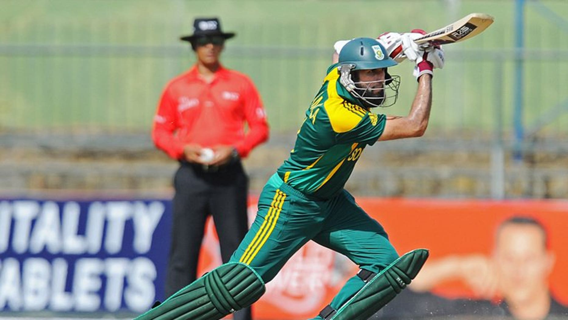 South African cricketer Hashim Amla plays a shot during the fourth One Day International with Sri Lankam July 28, 2013. Amla has joined Surrey until the end of the season, the English county side announced on Wednesday.