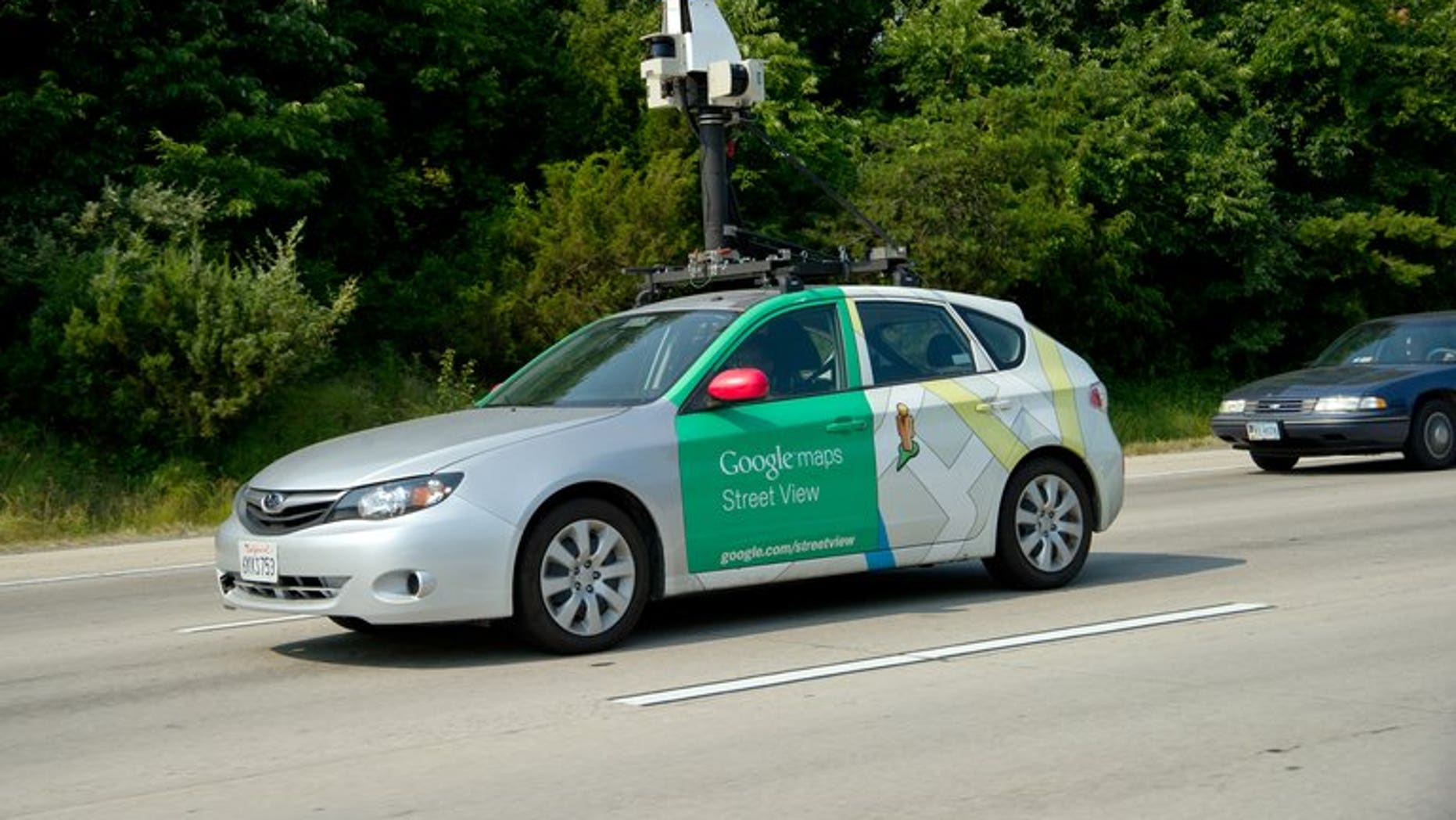 "This June 28, 2012 photo shows a Google Street View vehicle as it collects imagery while driving down Interstate I-66 near Centreville, Virginia. Thai villagers on Wednesday apologised for mistaking a Google worker for a government snoop as he carried out mapping for the Internet giant's ""Street View"" programme in a remote area."