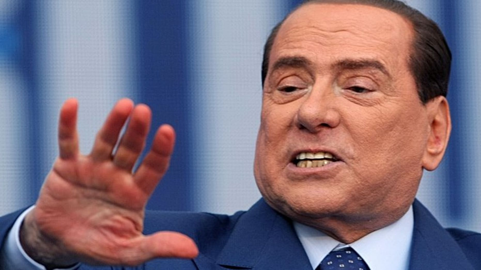 Former Italian premier Silvio Berlusconi delivers a speech during a campaign rally in Bari, on April, 13, 2013. Berlusconi's lawyer said he believed the former premier would request -- and could be granted -- a presidential pardon following his tax fraud conviction, sparking a heated debate in Italy.