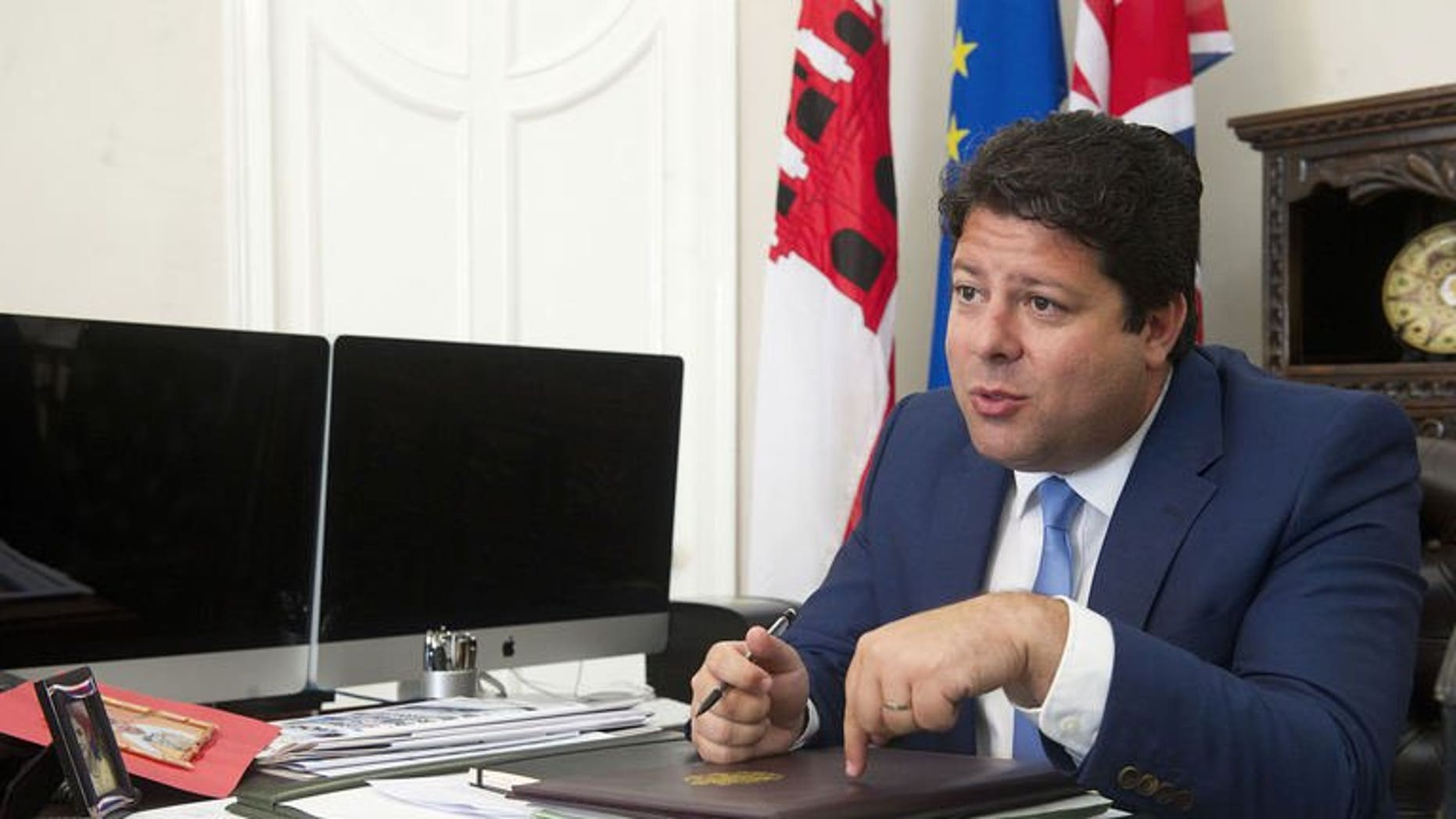 Gibraltar's Chief Minister Fabian Picardo speaks during an interview with AFP in his Convent Place office, Gibraltar, on August 14, 2013.