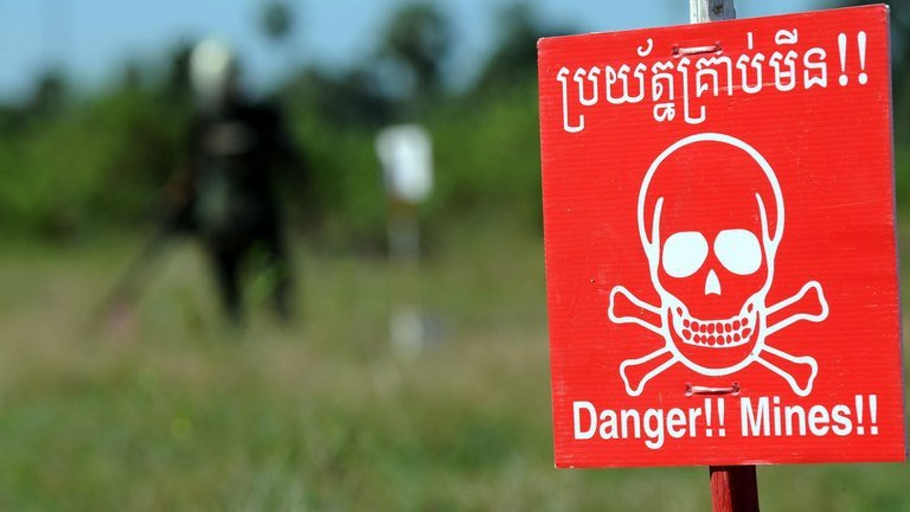 In this file photo, a deminer scans for mines at the Training and Mine Unexploded Ordnance Clearance Center in Oudong, some 40 km north of Phnom Penh, on November 27, 2011. Six Cambodian farmers were killed when their truck on Wednesday hit an old anti-tank mine planted by Khmer Rouge guerrillas during the country's civil war.