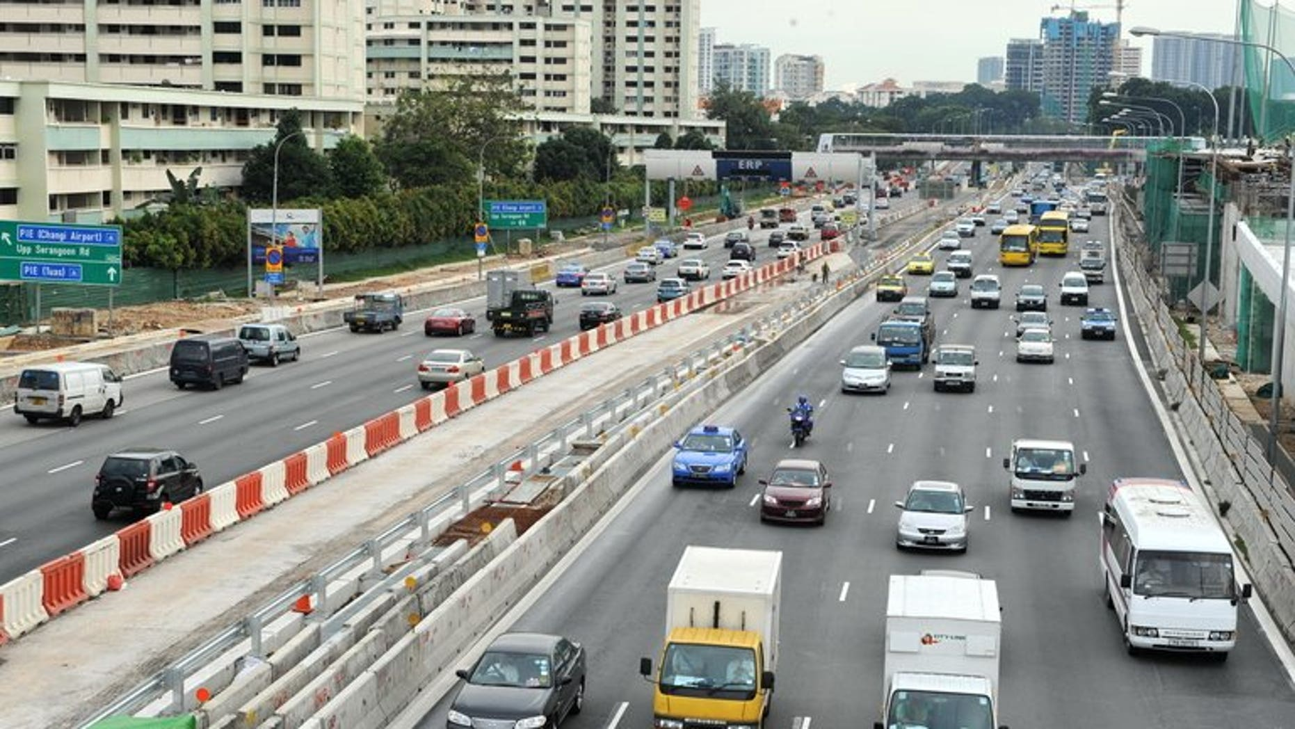File photo of traffic on a central expressway in Singapore. A Singapore bus driver has been fired after he was caught on video trimming his nails while driving along an expressway.