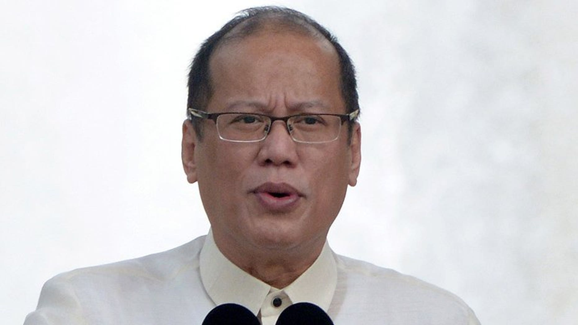 Philippine President Benigno Aquino addresses the crowd during a ceremony in Manila, on June 12, 2013. Aquino -- who previously survived a deadly assassination attempt during his struggle to the top of bare-knuckle Philippine politics -- has been laid low by his allergy to flowers.