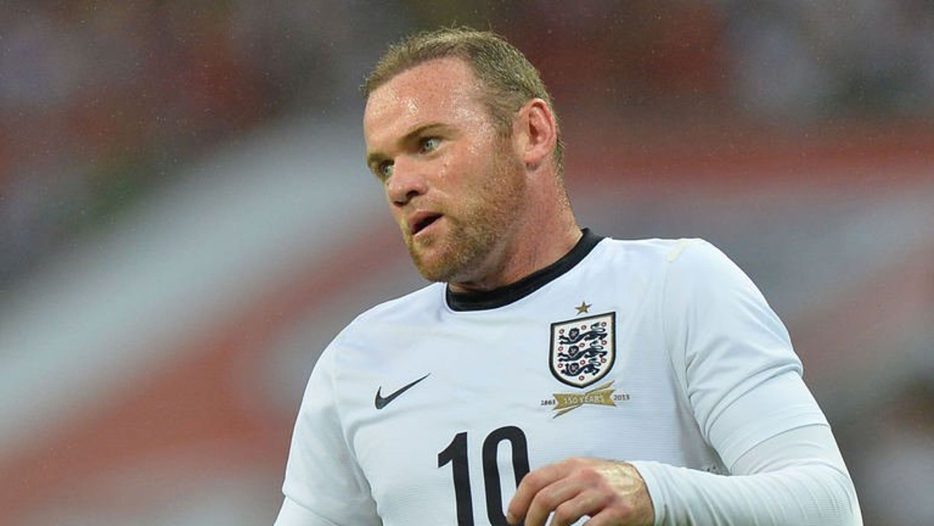 England striker Wayne Rooney plays during the international friendly with Scotland at Wembley Stadium in London on August 14, 2013. Manchester United manager David Moyes said he will assess Rooney's fitness before deciding whether to field the unsettled striker in the club's opening Premier League game.