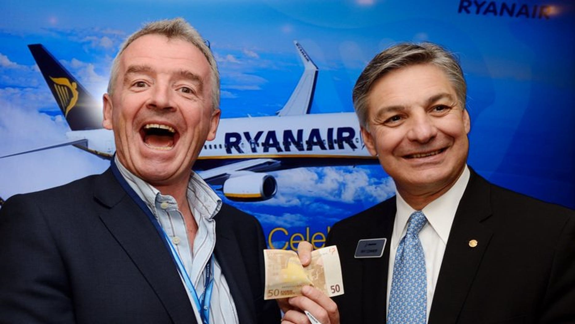 Ryanair chief executive officer Michael O'Leahry (left) and Boeing Airplane President Ray Conner on June 19, 2013 at Le Bourget airport, Paris. Ryanair has fired a pilot who contributed to a British television documentary that raised fears over its fuel policy, the Irish no-frills airline has announced.