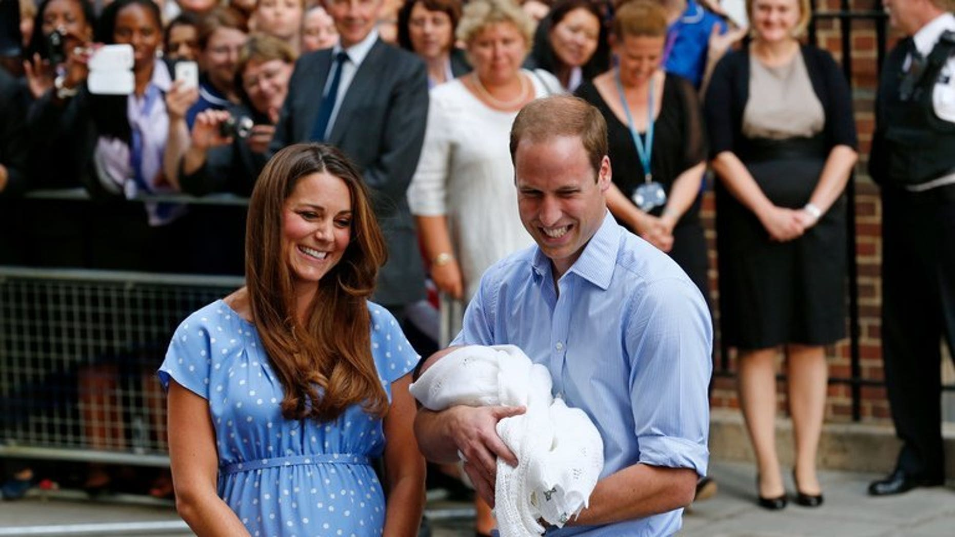 Prince William and Catherine with Prince George outside St Mary's Hospital in London on July 23. Kate will next month attend her first public engagement since giving birth, when she takes part in a charity event with her husband, the palace said on Thursday.