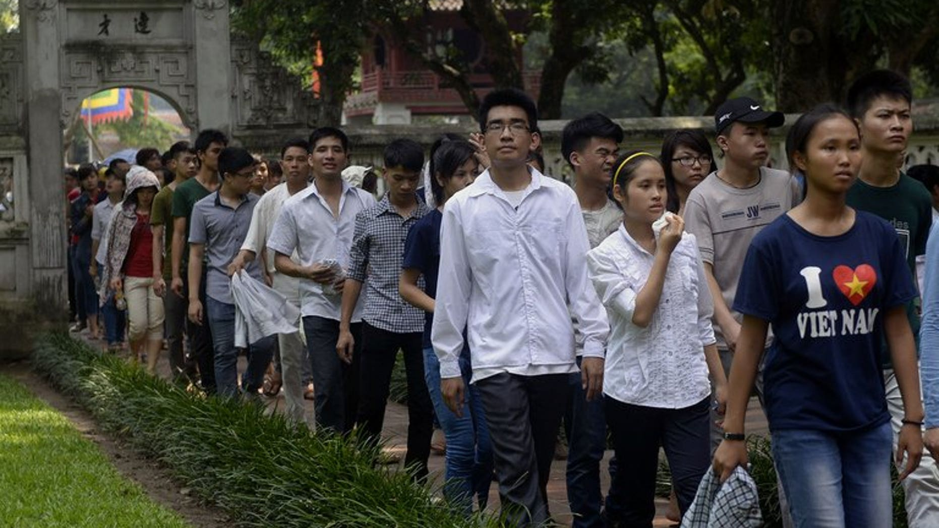 Students walk inside the temple of literature at Vietnam's first national university on July 2, 2013 as they come to pray for luck prior to the admission exams for a college seat. Vietnam is offering free classes in Marxism, Leninism and the teachings of Ho Chi Minh in a bid to revive interest in the ideology behind the country's system of government.