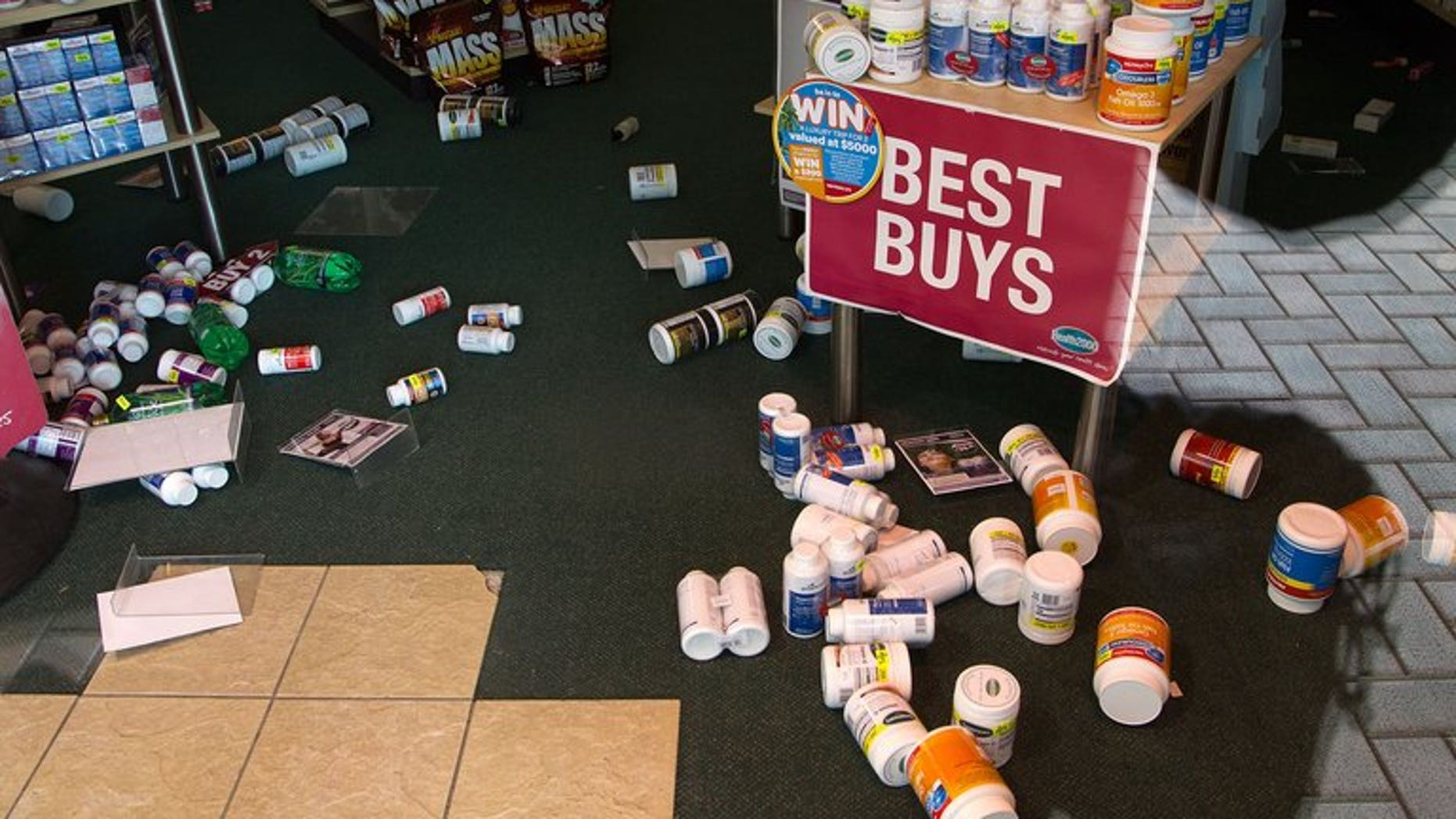 Stock lays on the floor inside a retail store in Wellington on July 22, 2013, following an earthquake a day earlier. There have been hundreds of aftershocks since the July quake.