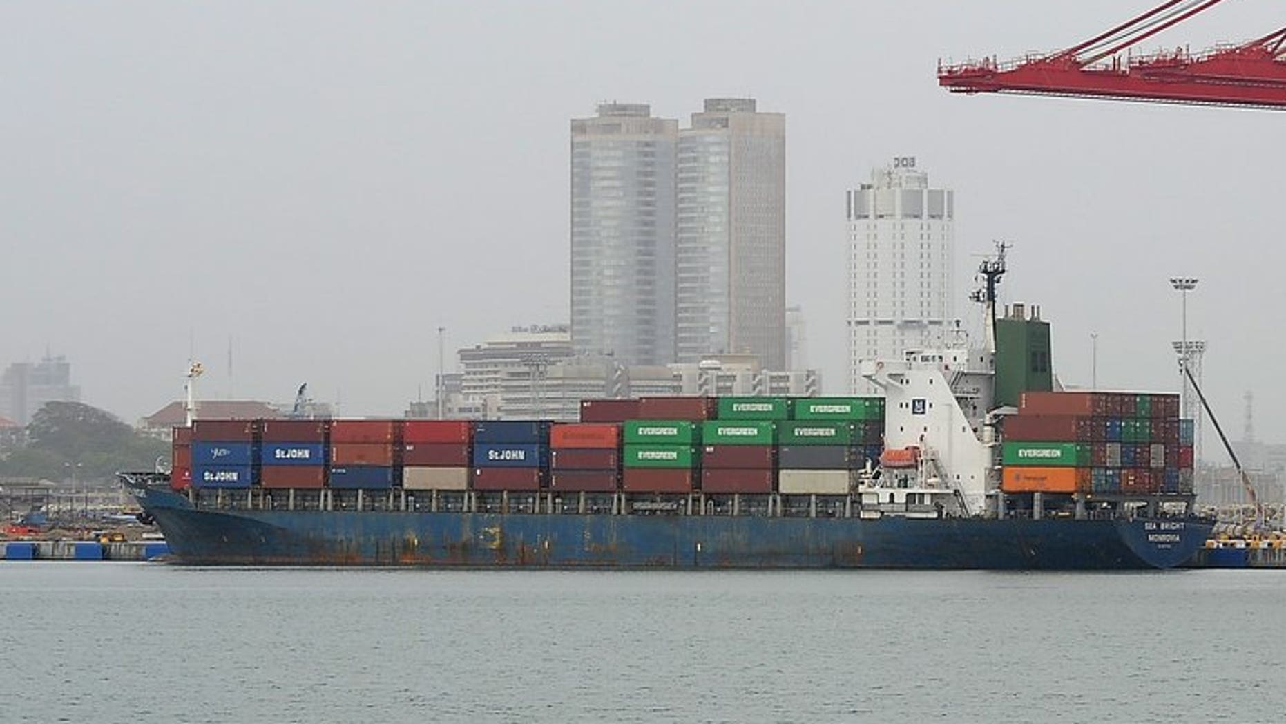 Illustration: a container ship is pictured at the Chinese-built harbour in Sri Lanks on July 24, 2013. China will cut days from each journey its ships make to Europe by using the Northeast Passage through the Arctic Ocean