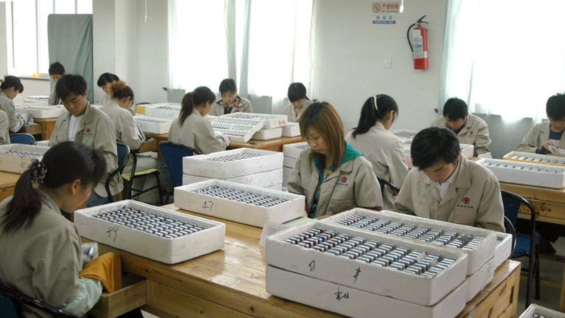Workers assemble lighters at the Rifeng factory in Wenzhou, China's Zhejiang province in 2006. A former vice mayor of China's eastern city of Wenzhou was Friday sentenced to three years in jail for abuse of power in a land deal, state media reported.