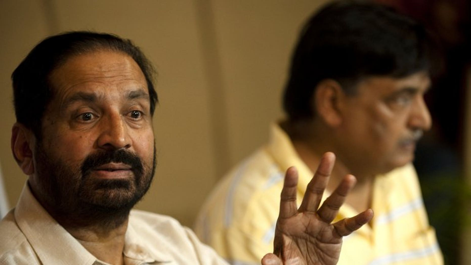 Former Indian Olympic Association (IOA) chief Suresh Kalmadi (left) and Lalit Bhanot give a press conference in New Delhi, on September 2, 2010. The IOC has sent a 43-page draft constitution that needs to be adopted by the suspended Indian Olympic Association (IOA) before its next elections in September, an Indian Olympics official has told AFP.