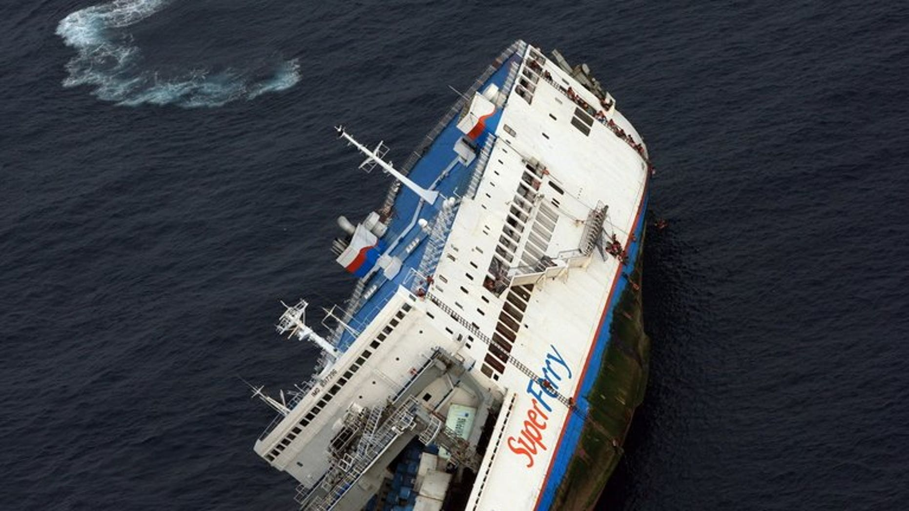 File picture of Superferry 9 listing off Zamboanga peninsular in September 2009. The Philippines coastguard launched a rescue mission Friday night after a ferry carrying almost 700 people collided with a cargo ship off the central city of Cebu, officials said.