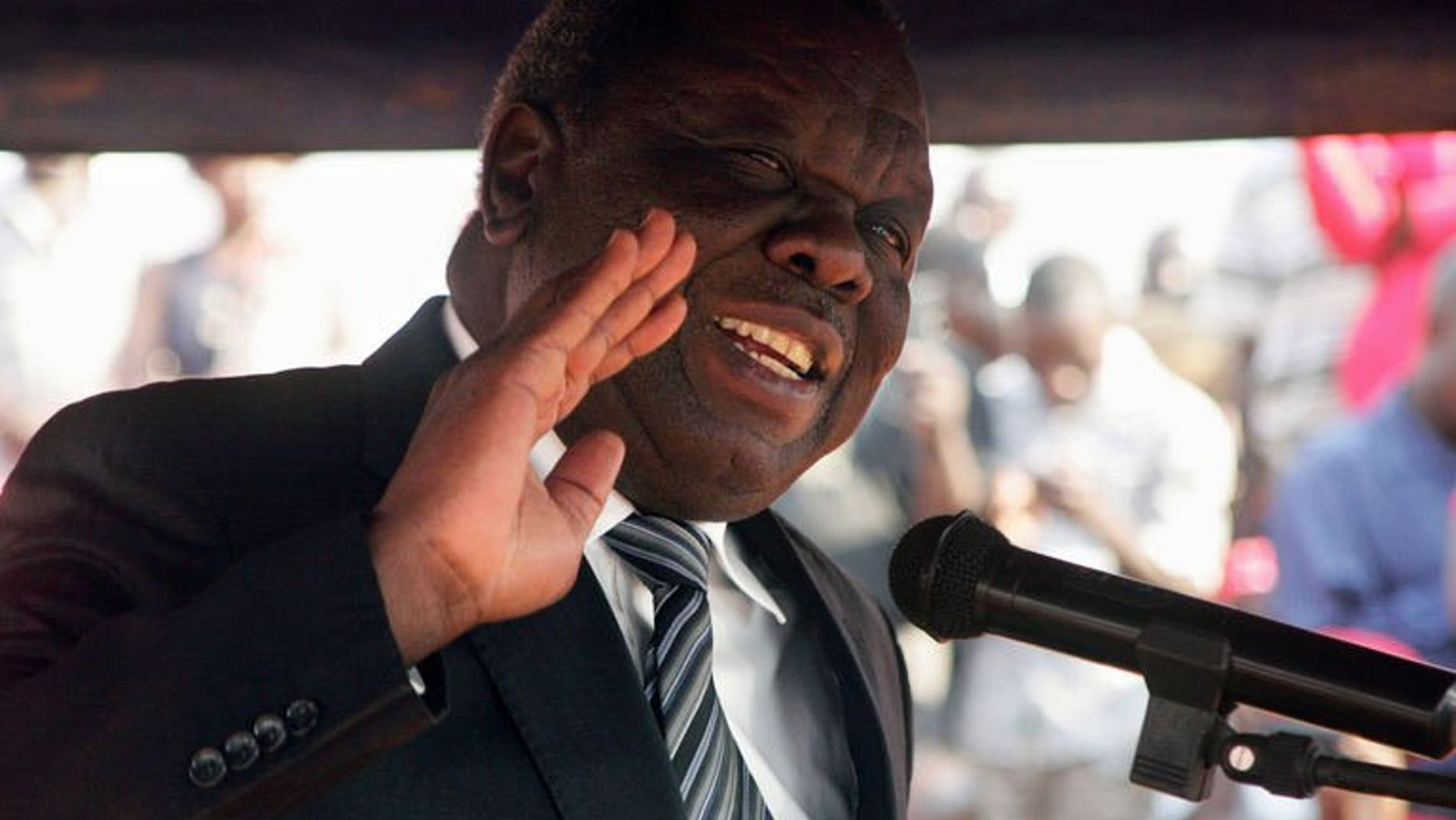 Movement for Democratic Change (MDC) Zimbabwe opposition leader, Morgan Tsvangirai, addresses mourners during the burial of Rebecca Mafikeni, a party activist of the MDC on August 14, 2013 in Harare. Tsvangirai on Friday withdrew a legal challenge against the outcome of last month's disputed election, his MDC party said, claiming the legal process would not be fair.