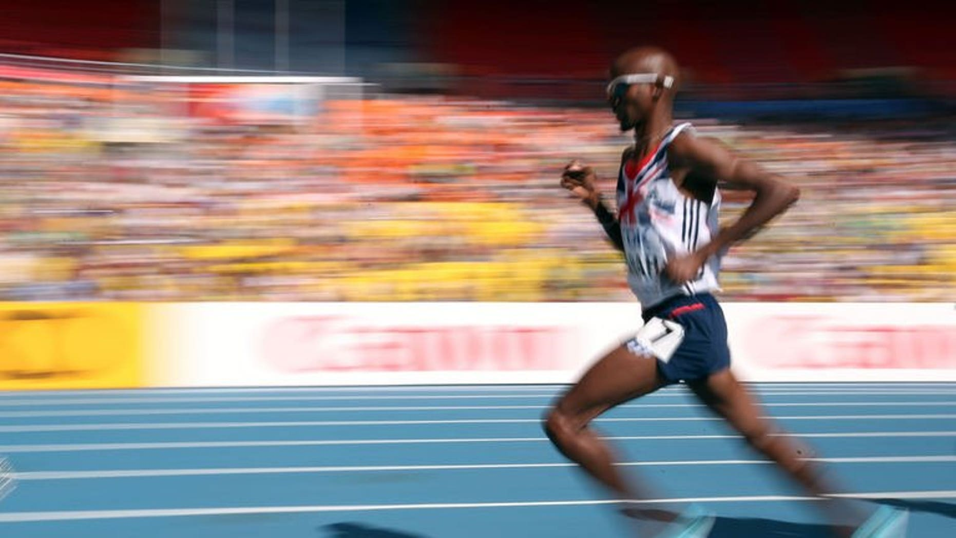 Britain's Mohamed Farah competes in Moscow on August 13, 2013. Farah added the men's 5,000m gold to his 10,000m crown at the World Athletics Championships on Friday.