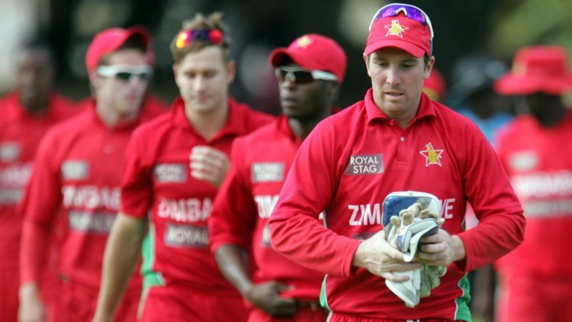 Zimbabwe's captain Brendan Taylor leaves the field with teammates at Queens Sports Club on August 3, 2013 in Harare. Zimbabwe's cricketers have returned to training after a brief stand-off with Zimbabwe Cricket over unpaid wages and the value of future contracts, ensuring that Pakistan's tour of the country will go ahead as planned.