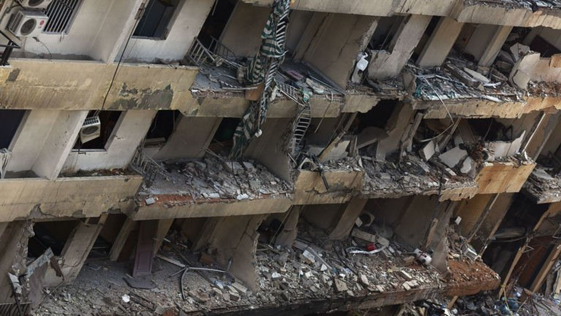 Destruction following a car bomb attack the previous day that killed at least 22 people in a Beirut stronghold of Shiite group Hezbollah on August 16, 2013. The Gulf Cooperation Council has condemned the car bombing that killed at least 22 people.