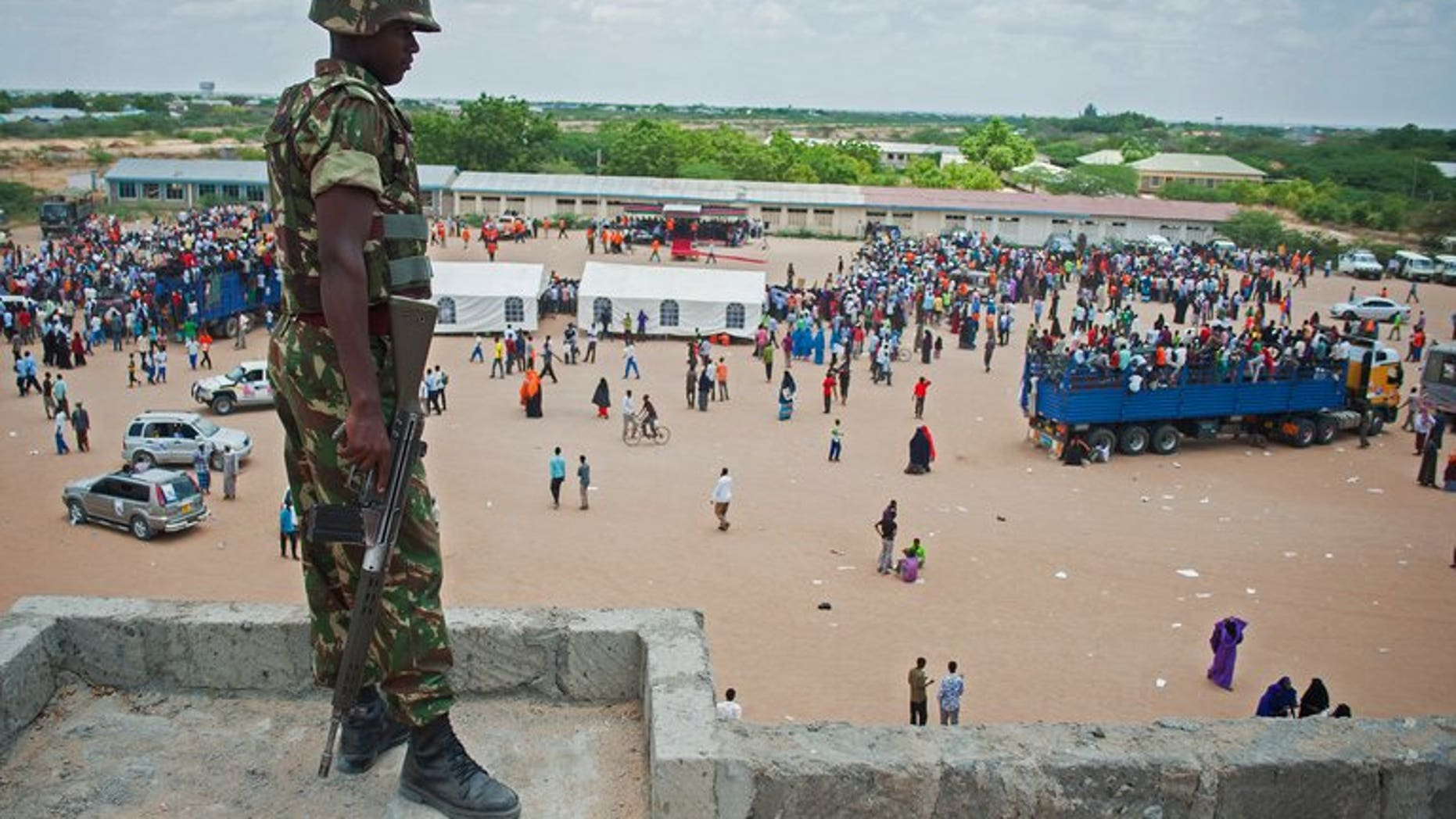 A Kenyan soldiers watches a political rally in Garissa on February 27. An attack blamed on Somali Islamist insurgents left four people dead in eastern Kenya and prompted hundreds to flee into the bush, authorities and the Red Cross said Saturday.