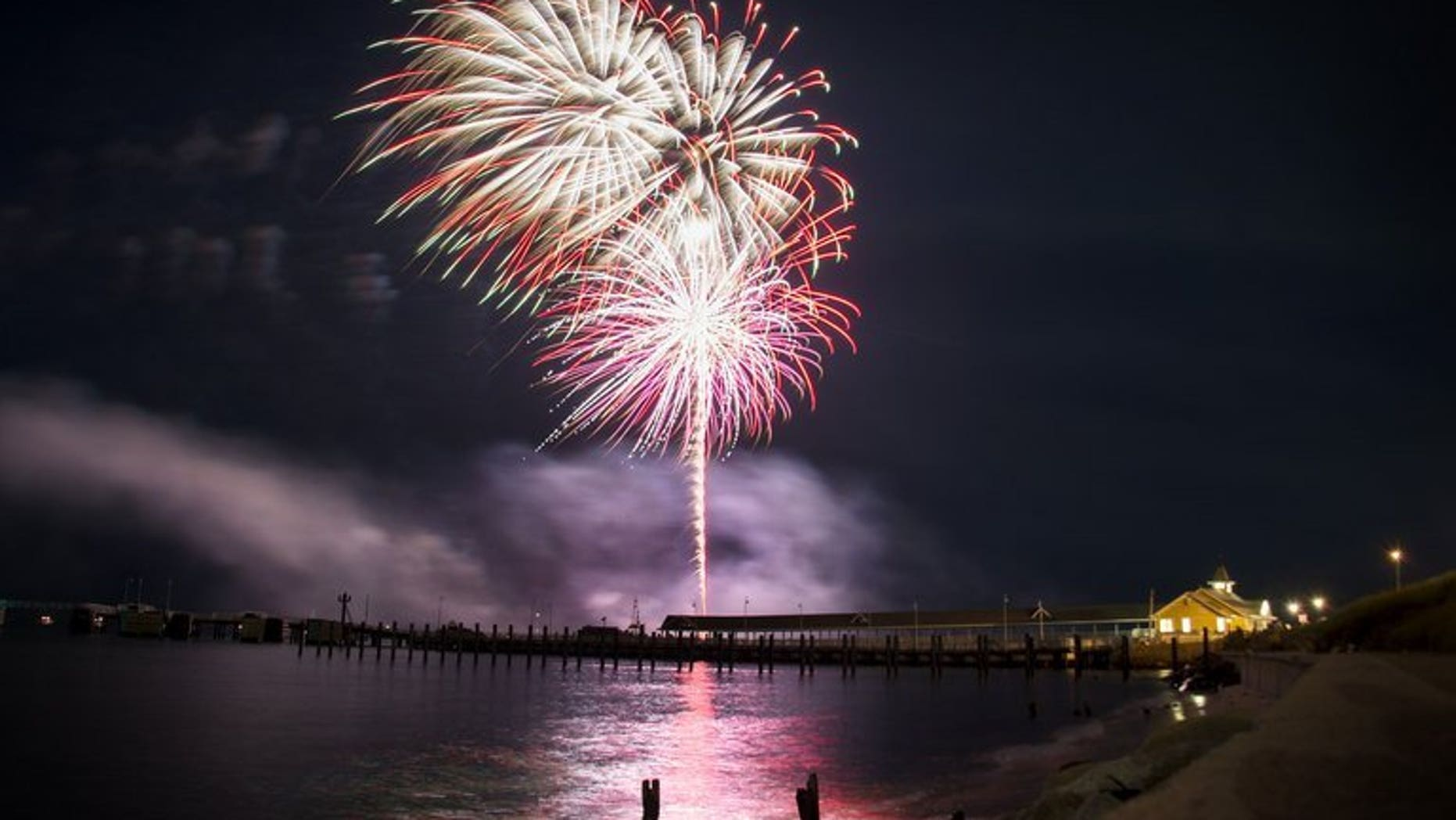 Fireworks go off over Oak Bluff Harbor in Oak Bluffs, Massachusetts, August 16, 2013. A 44-year-old woman who suffered severe burns in an explosion at a fireworks festival in western Japan two days ago became the first person to die from the accident on Saturday, police said.