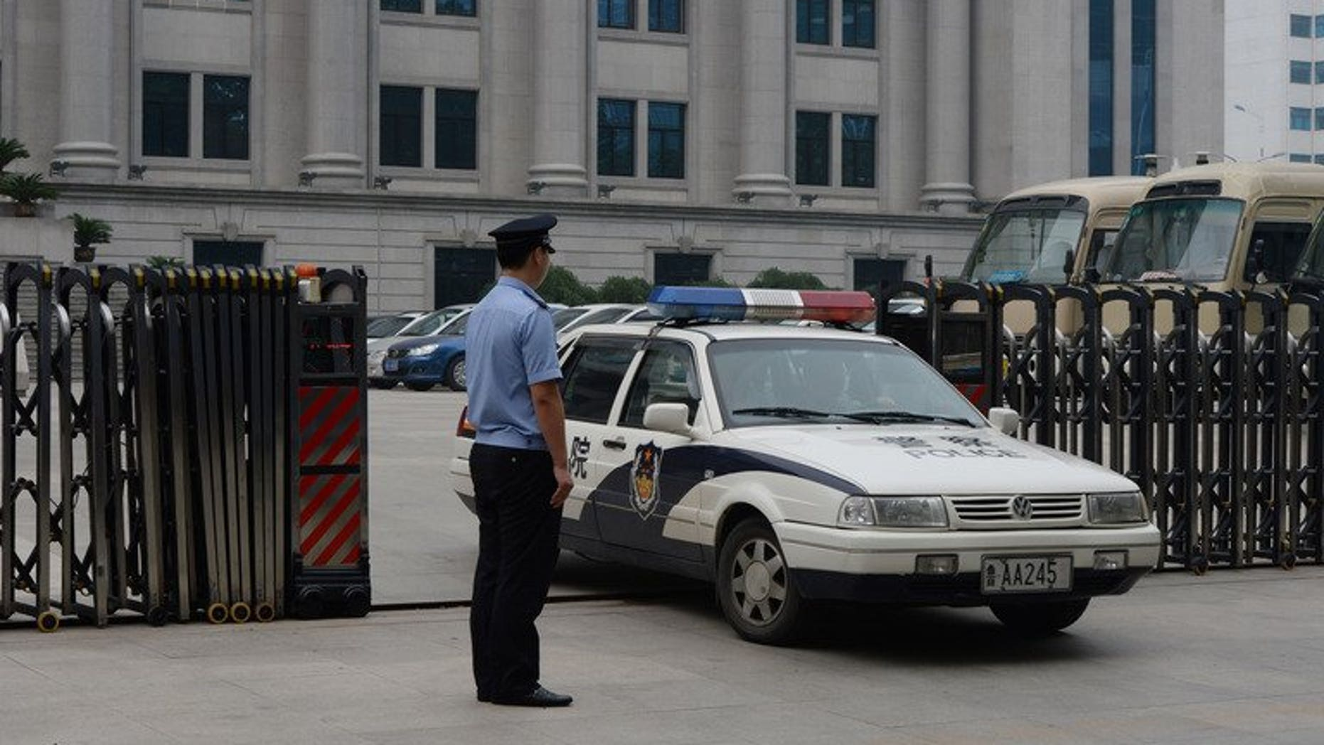 Police leave the Intermediate People's Court in Jinan, Shandong Province on July 25, 2013. Chinese police have detained a prominent human rights activist, signalling the continuation of a recent crackdown on dissent, an advocacy group said on Saturday.