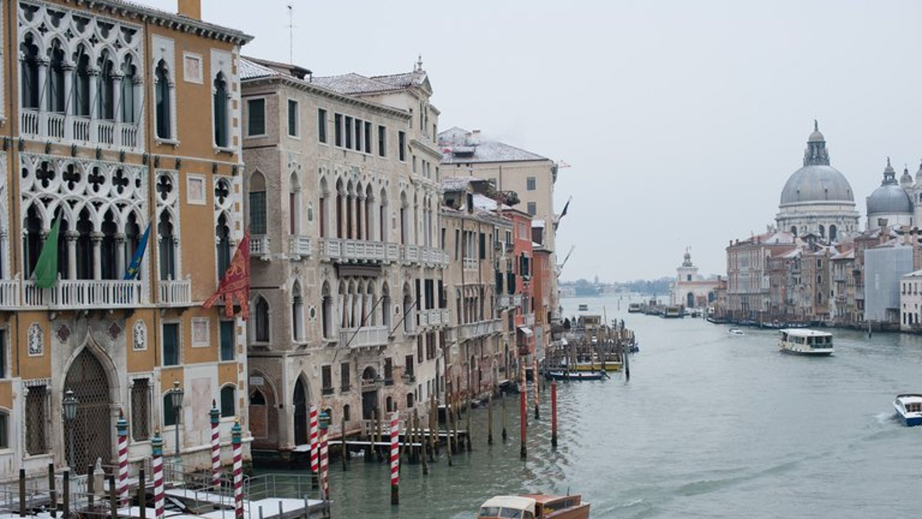 A picture taken on February 12, 2012 shows boats sailing on the Grand Canal in Venice. A gondola and a vaporetto waterbus collided Saturday on Venice's Grand Canal, killing a German tourist and badly injuring a young girl, Italy's Ansa news agency reported.