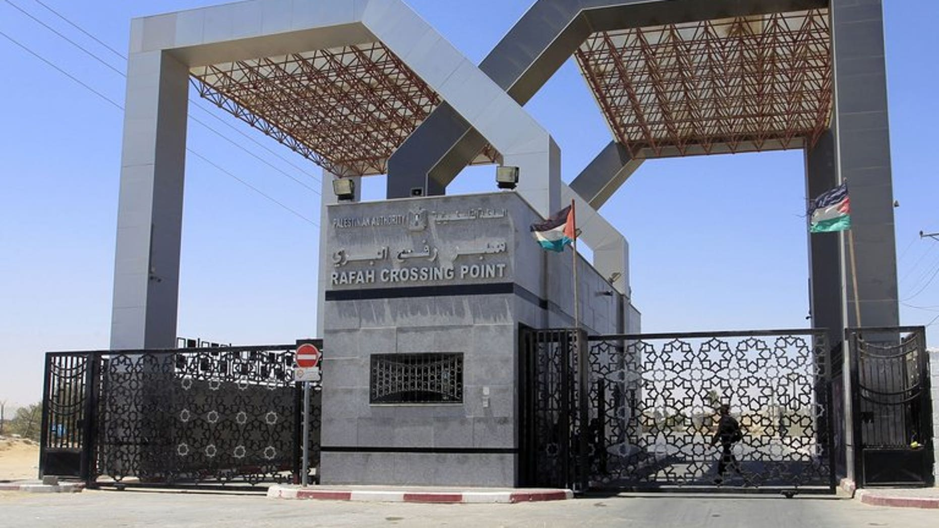 A picture shows the closed gates of the Rafah crossing point with Egypt in the southern Gaza Strip on July 5, 2013. Egyptian authorities allowed the entry of a bus from Gaza on Saturday, the Hamas government said, two days after Cairo had indefinitely closed its border crossing with the Palestinian enclave.