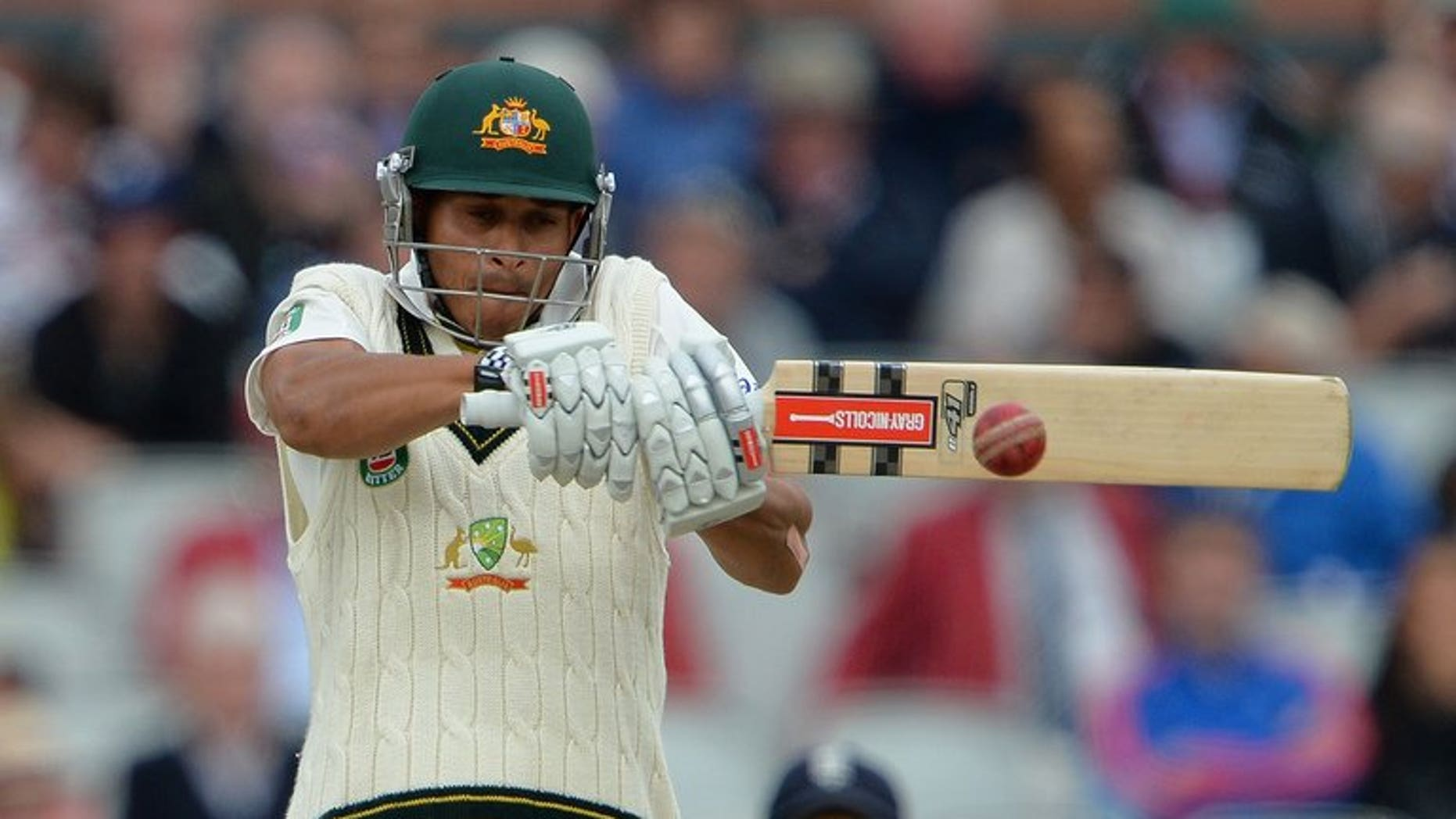 Australia's Usman Khawaja plays a shot at Old Trafford in Manchester, north-west England on August 4, 2013. Khawaja suffered another low score as the tourists warmed-up for next week's final Ashes Test with a draw against the second-string England Lions on Saturday.