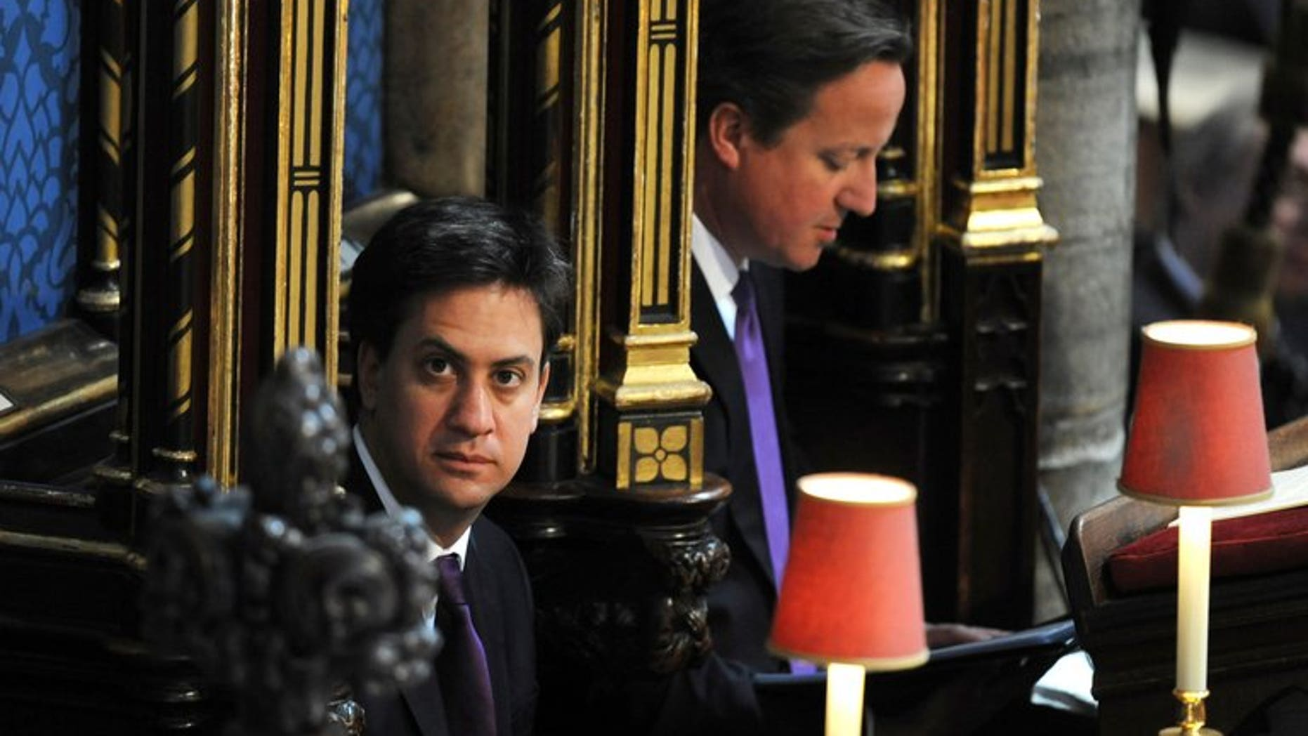 Prime Minister David Cameron (R) and Labour Party leader Ed Miliband attend a service at Westminster Abbey in London on June 4, 2013. Miliband has suffered a summer ratings slump, a poll out Sunday showed.