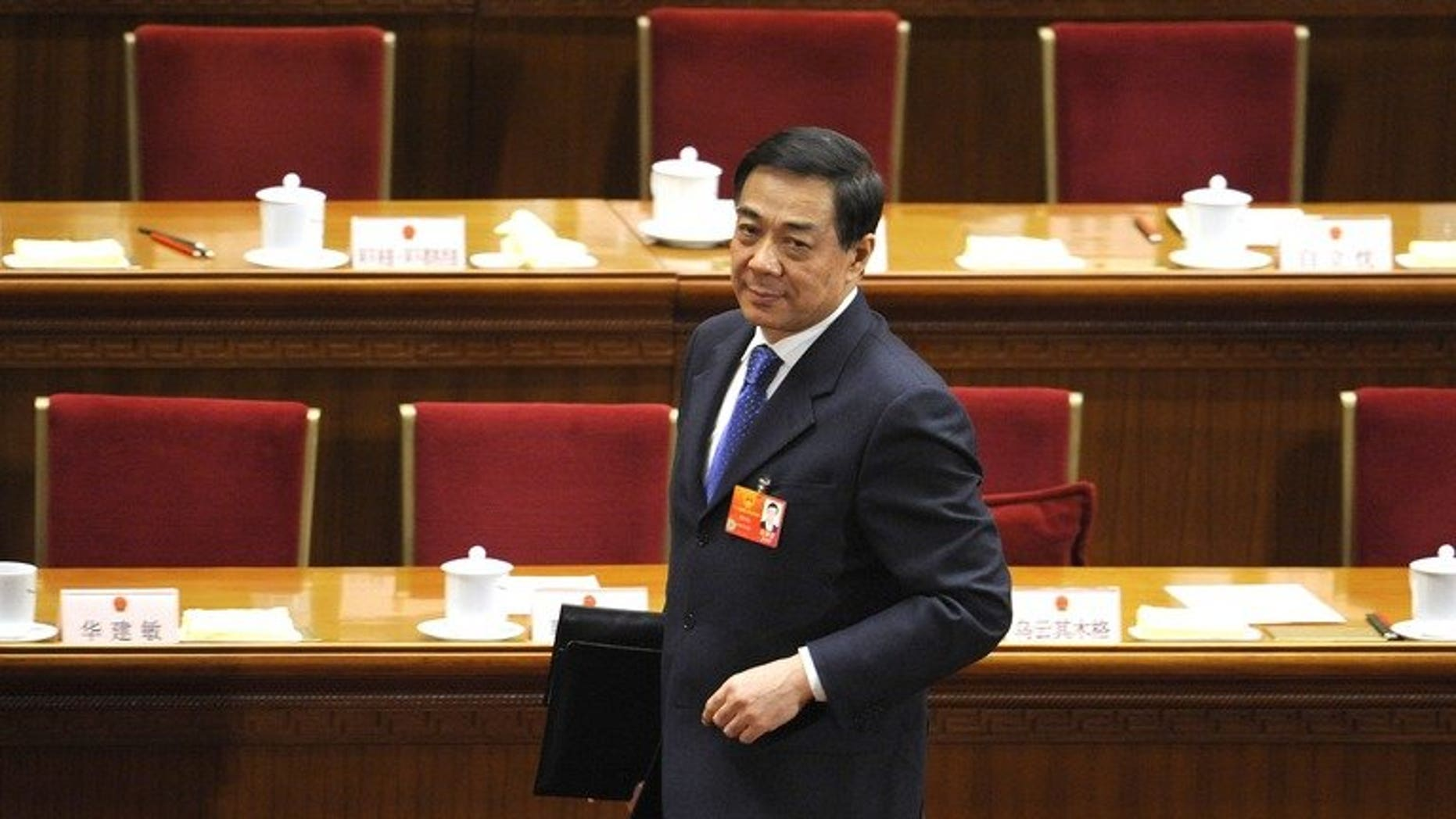 In a file photo taken on March 9, 2012, Bo Xilai leaves after the third plenary session of the National People's Congress's (NPC) annual session at the Great Hall of the People in Beijing. Bo will stand trial from Thursday, state media said on Sunday.