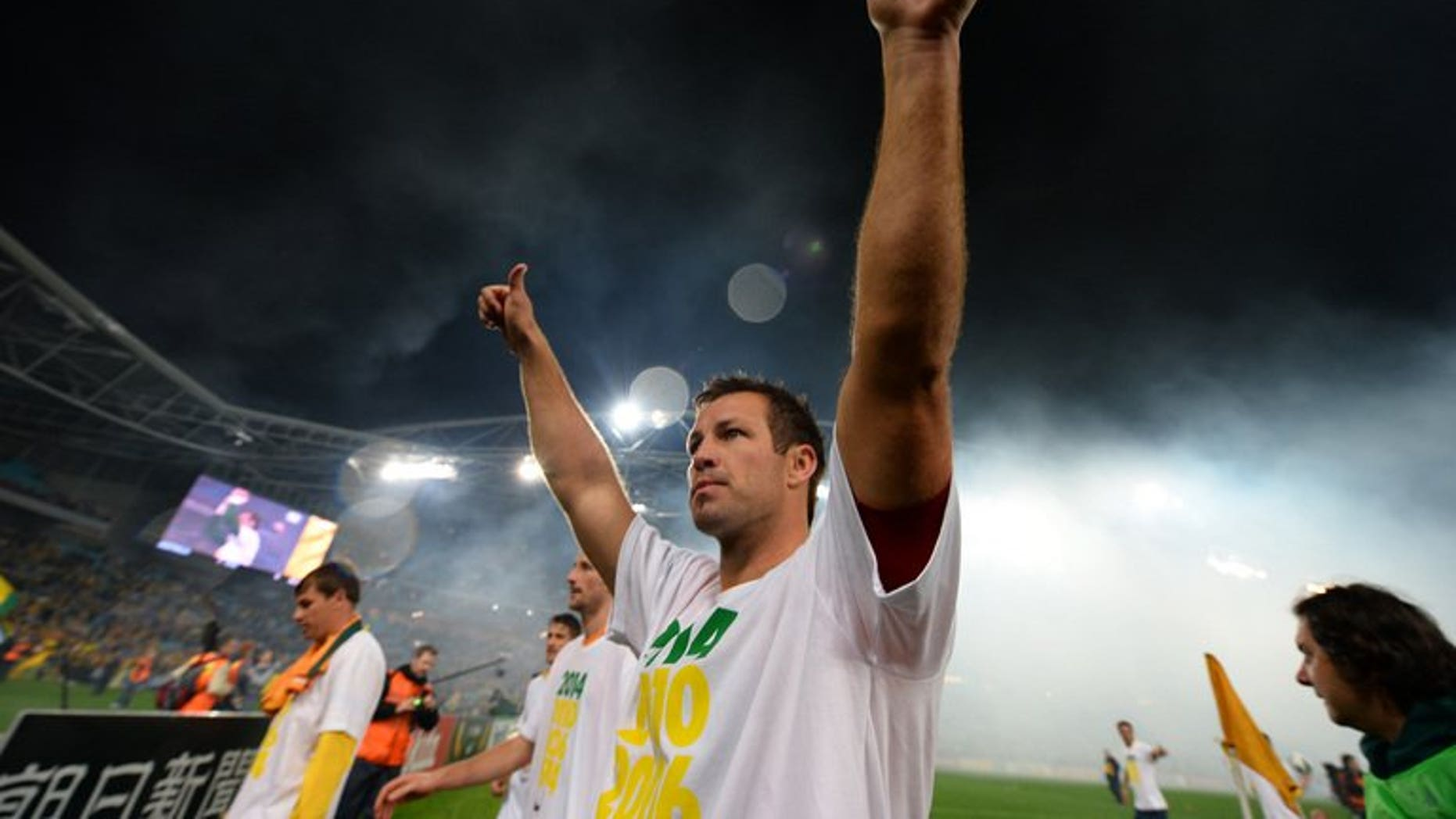 Australia's captain Lucas Neill acknowledges the crowd after his team's win against Iraq during their 2014 World Cup qualifier in Sydney on June 18, 2013. Neill has signed a contract with Japan's Omiya Ardija and is ready to play as early as next weekend, the J-League club announced Sunday.