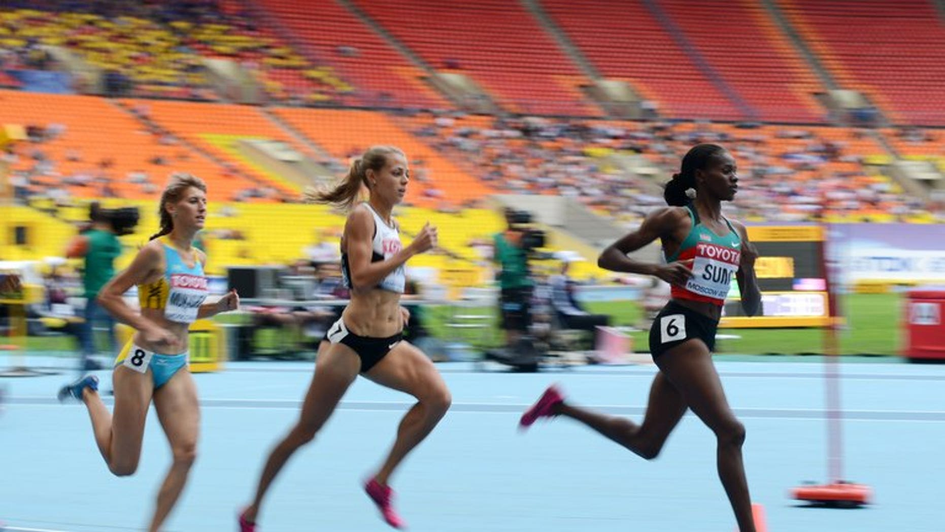 Eunice Sum (right) runs in the World Championships women's 800 metres heats in Moscow on August 15. The 25-year-old Kenyan timed 1min 57.38sec with Russia's defending champion Mariya Savinova taking silver (1:57.80) and Brenda Martinez of the United States the bronze (1:57.91).