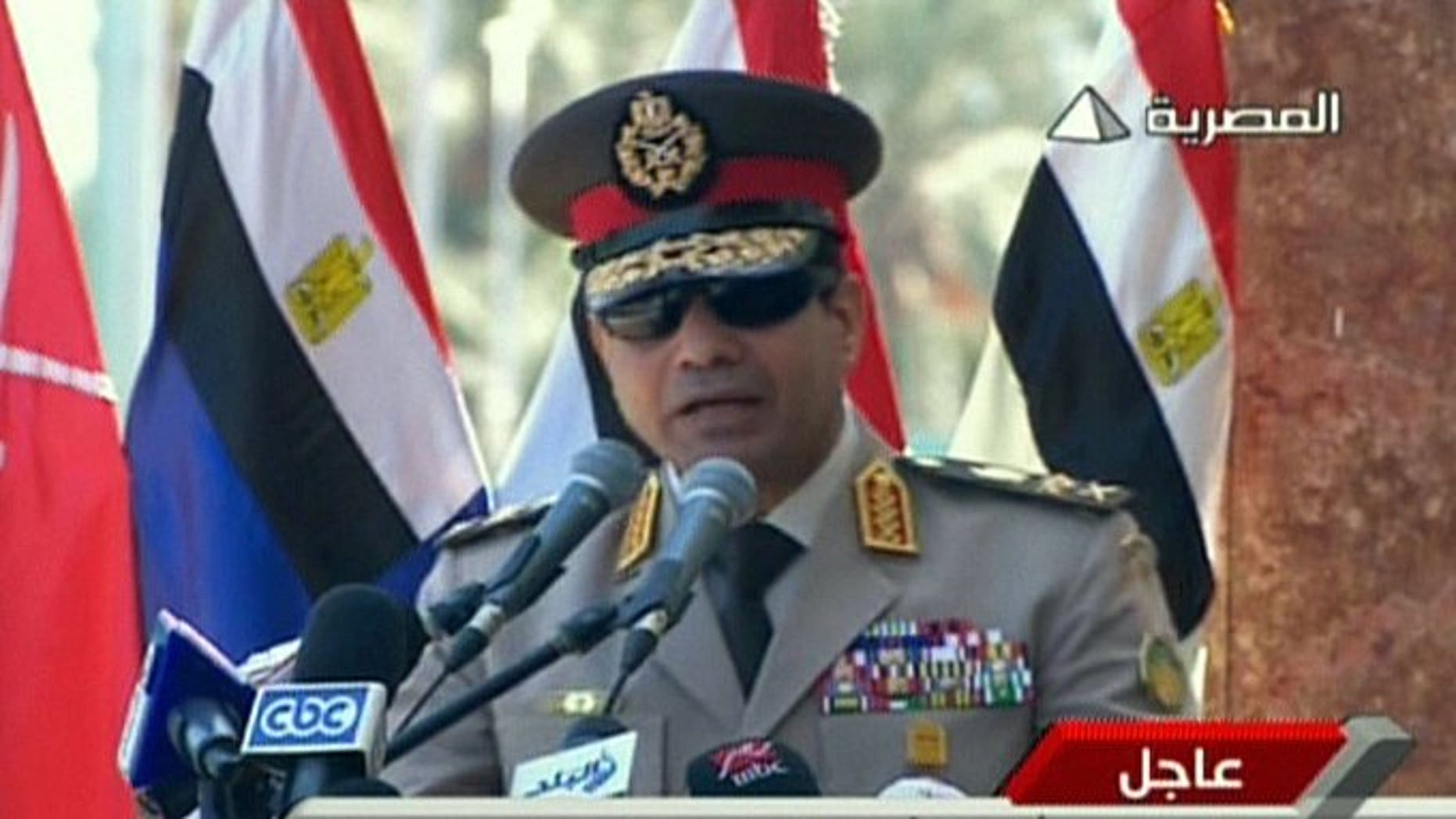 """An image grab taken from Egyptian state TV shows Egypt's army chief General Abdel Fattah al-Sisi giving a live broadcast calling for public rallies to give him a mandate to fight """"terrorism and violence"""". Egypt's army chief vowed Sunday to stand firm in the face of violence by Islamists, in his first remarks since a deadly crackdown on supporters of ousted president Mohamed Morsi."""