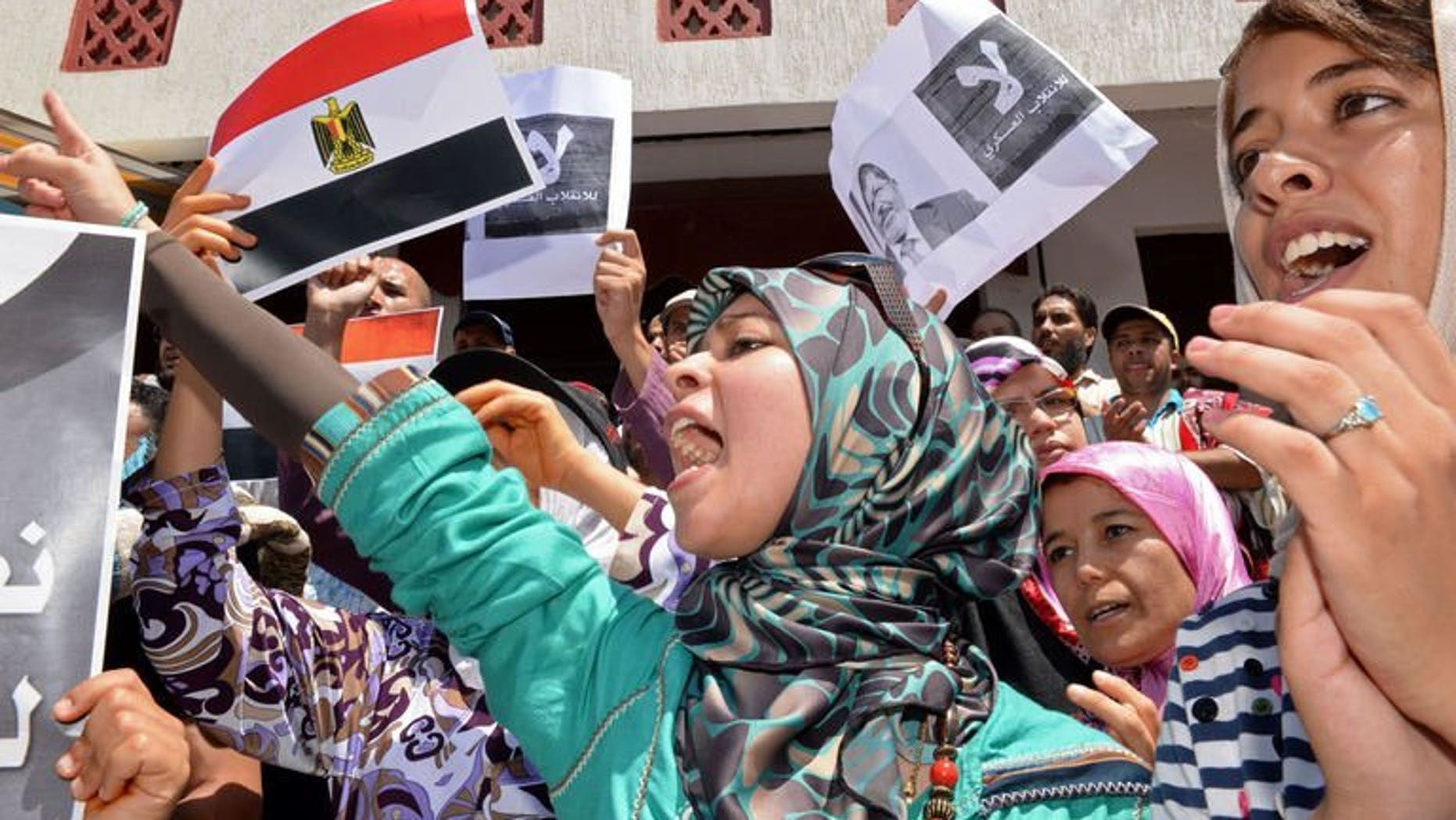 Moroccan protestors hold Egyptian flags during a rally in Rabat against the violence in Egypt on August 16, 2013. Around 10,000 people took part in a demonstration in the Moroccan capital on Sunday in support of Islamists in Egypt locked in a deadly showdown with security forces.