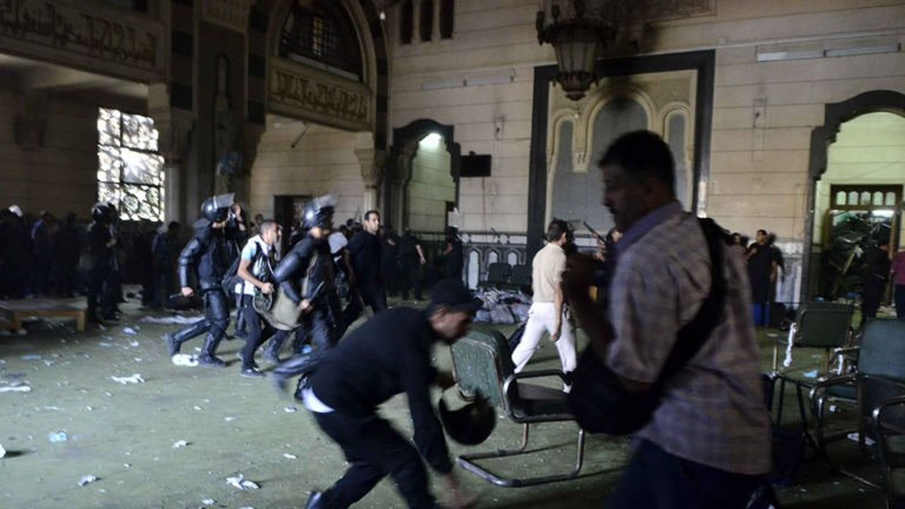 Egyptian riot policemen in Cairo's Al-Fath mosque where Islamist supporters of ousted Morsi holed up on August 17, 2013. Egyptian policemen fired tear gas at Islamist inmates who rioted and tried to escape during their transfer to a prison on Cairo's outskirts on Sunday, officials said.