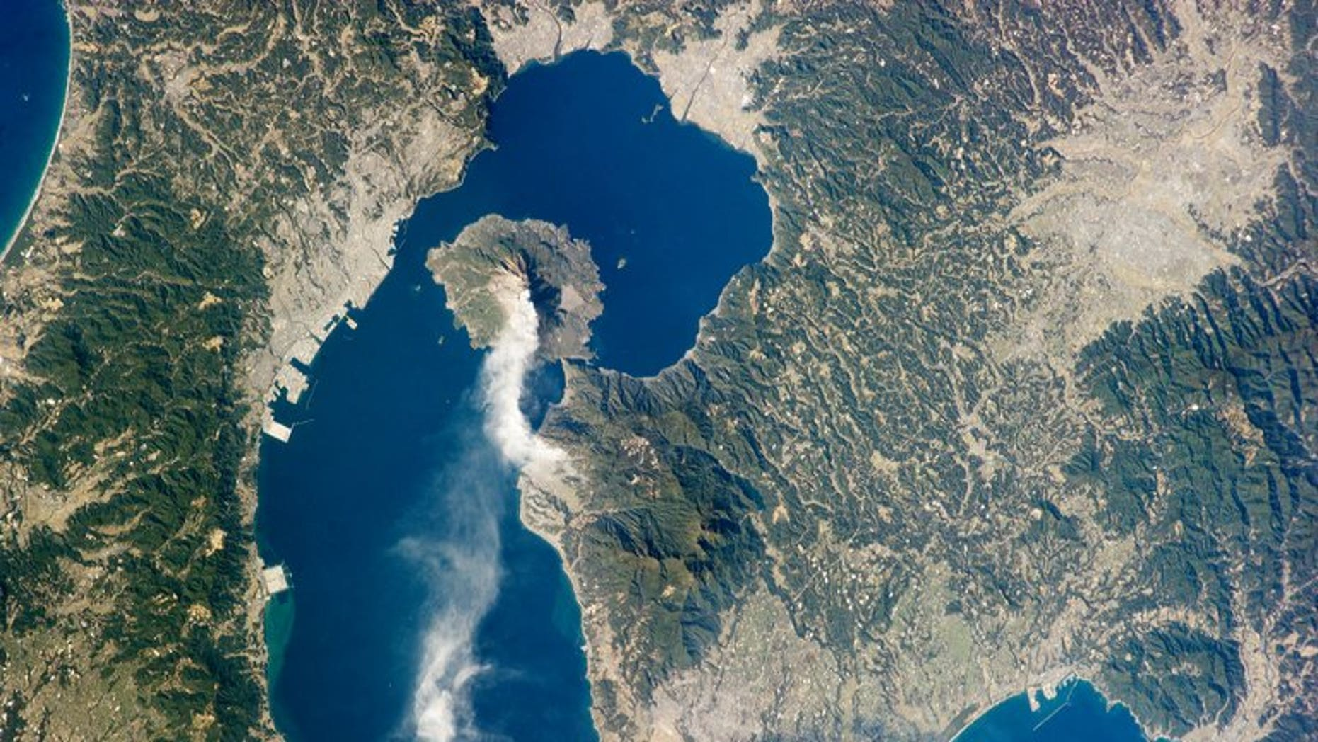 This image provided January 28, 2013 by NASA shows Japan???s Sakurajima volcano. The volcano in southern Japan erupted in spectacular fashion on Sunday, spewing an ash plume up to 5,000 metres into the air, meteorological officials said, according to a report.