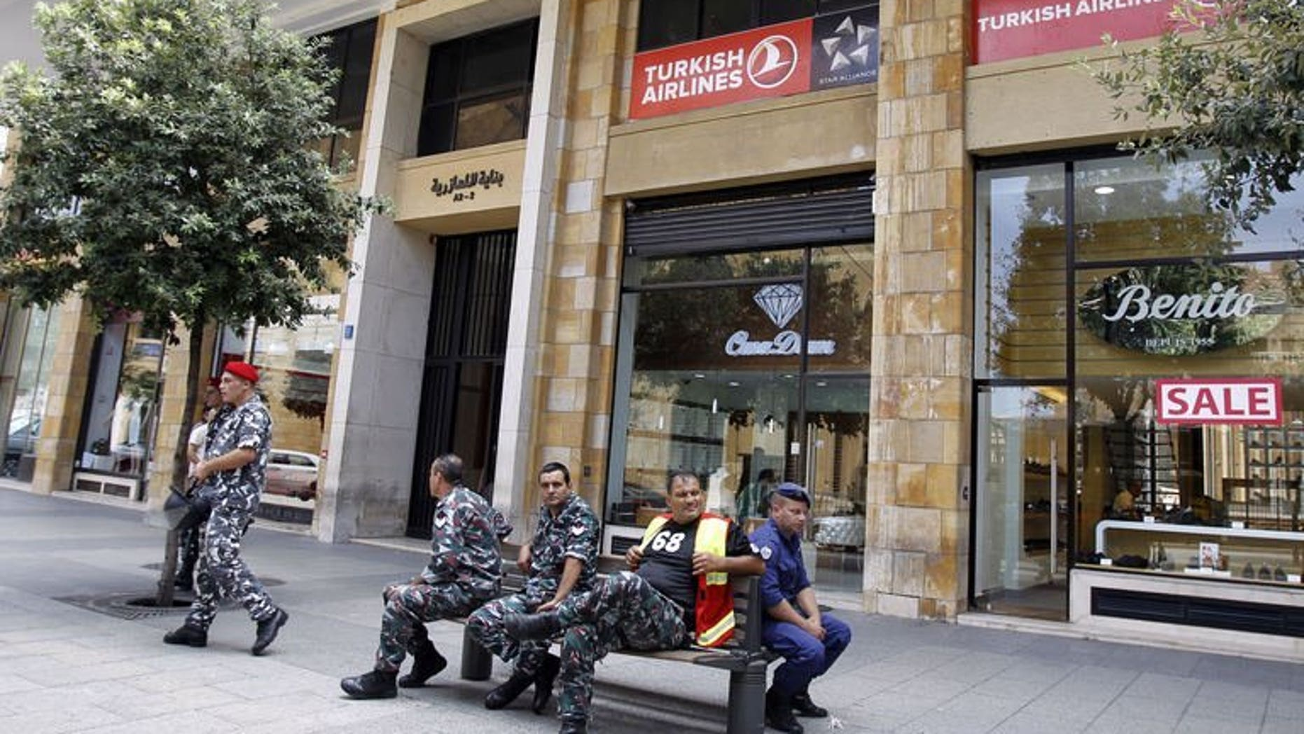 Members of the Lebanese internal security forces sit outside the Turkish Airlines offices in downtown Beirut on August 12, 2013. A Turkish pilot refused to fly a Beirut-bound plane from Istanbul in a show of protest against the kidnapping of two of his colleagues in Lebanon, local media reported Monday.
