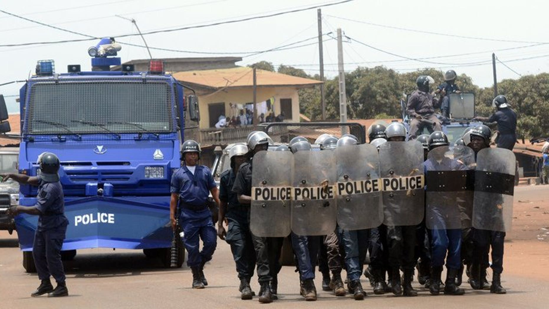 Guinea's police forces prepare to disperse a demonstration in Conakry on May 2, 2013. A radio station in the east of Guinea was ransacked by pro-government demonstrators for reporting on protests against President Alpha Conde, employees told AFP.