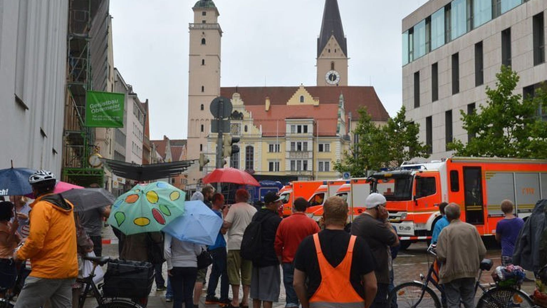 Onlookers stand in a street near the town hall in Ingolstadt, southern Germany, on August 19, 2013. A man claiming to be armed took several hostages in the town hall on Monday, police said.