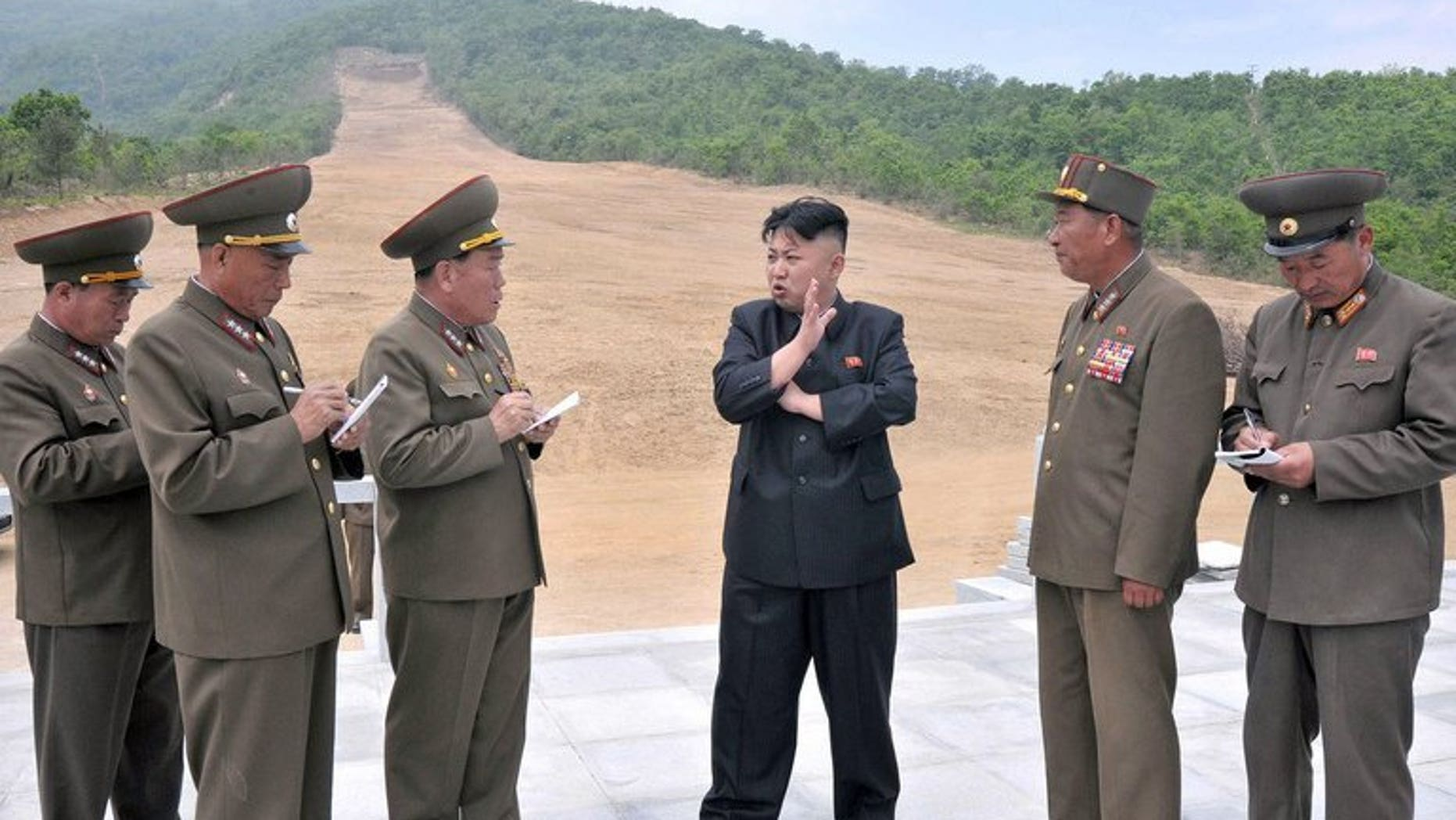 Undated recent photo released by North Korea's official Korean Central News Agency on May 27, 2013 claims to show North Korean leader Kim Jong-Un (C) talking to army officials at the Masik Pass Skiing Ground under construction by the Korean People's Army. Switzerland said Monday that it had blocked a deal to sell top-notch ski lifts to North Korea, in a move that could delay the ski project.