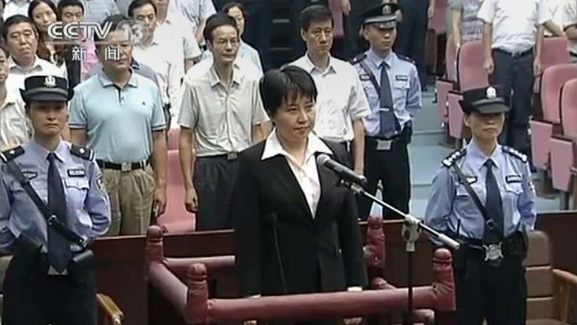 Gu Kailai, the wife of disgraced Chinese politician Bo Xilai, in court during her murder sentencing on August 20, 2012. Relatives of Neil Heywood, the British businessman Gu was convicted of murdering, are close to agreeing compensation with her representatives, a lawyer said Monday.