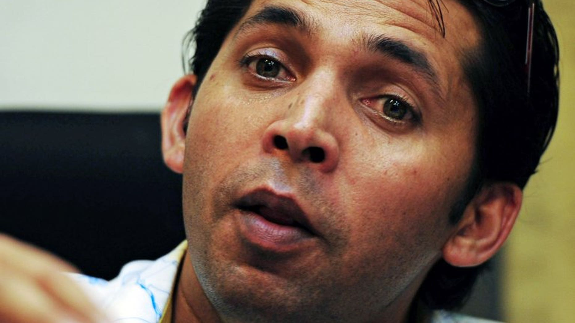 Mohammad Asif speaks during a news conference in Karachi on August 14. The banned Pakistan paceman on Monday spoke for the first time to the anti-corruption and vigilance wing of the cricket board as an initial step towards reviving his career.