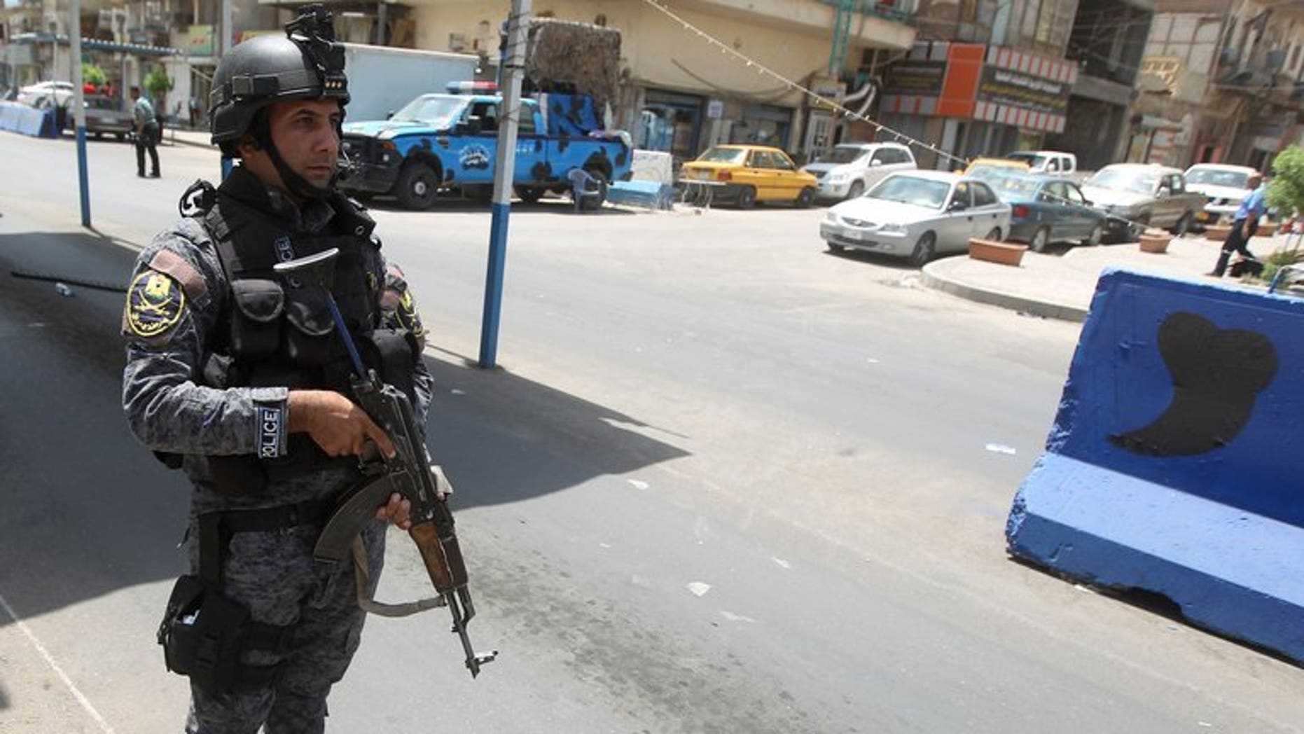 A policeman controls vehicles at a checkpoint on July 23, 2013 in the capital Baghdad, where security measures were imposed in order to catch the prisoners who escaped from Abu Ghraib prison after an attack. Iraq has put 17 people to death, 16 of them on terrorism-related charges, the justice ministry said Monday, the latest in a series of executions that have drawn international condemnation.