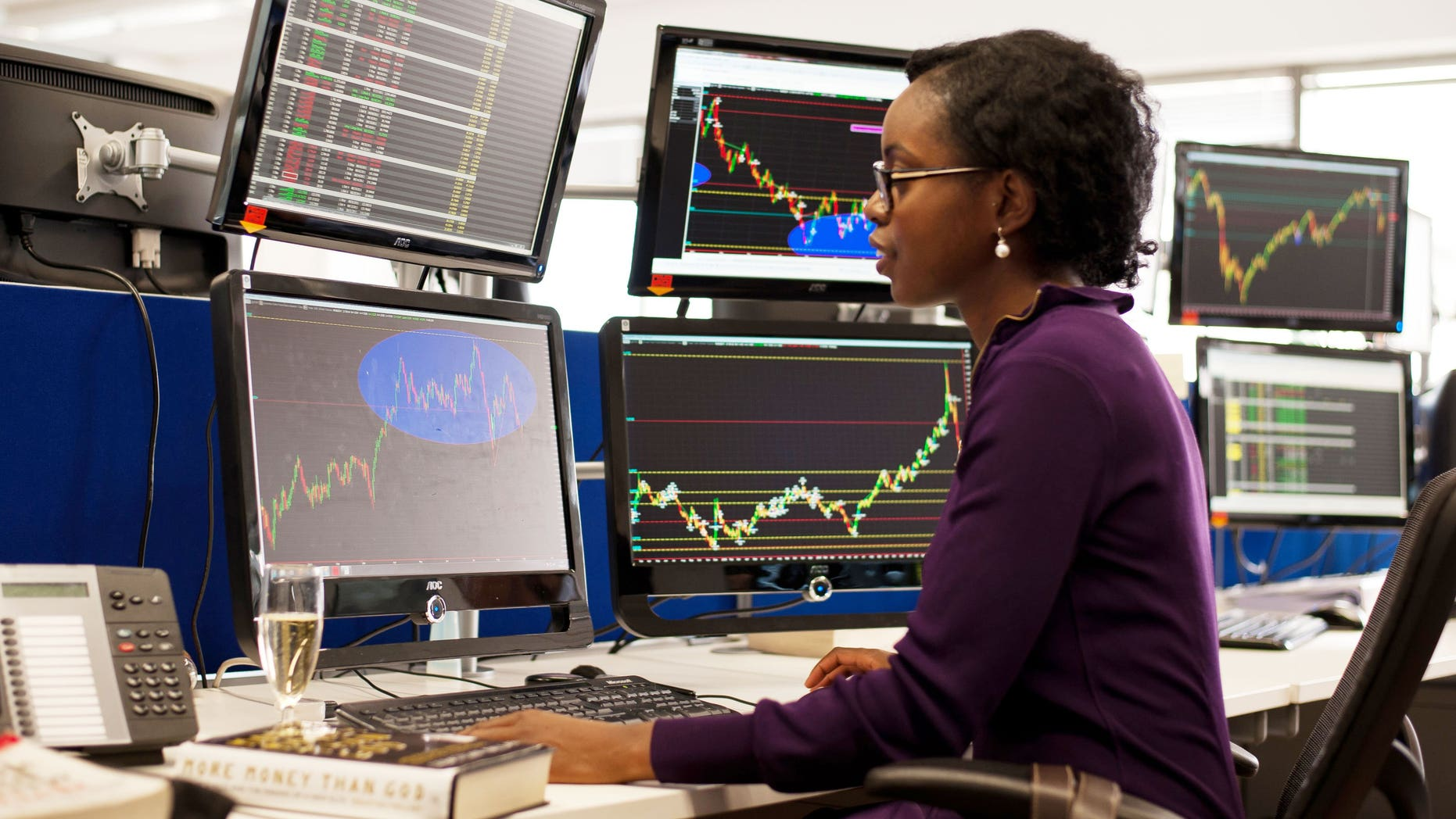 A woman on a trader training programme in London. London shares closed lower on Monday, led by Anglo American and Vedanta, as traders awaited further indications on when the Federal Reserve plans to reduce its huge stimulus programme.