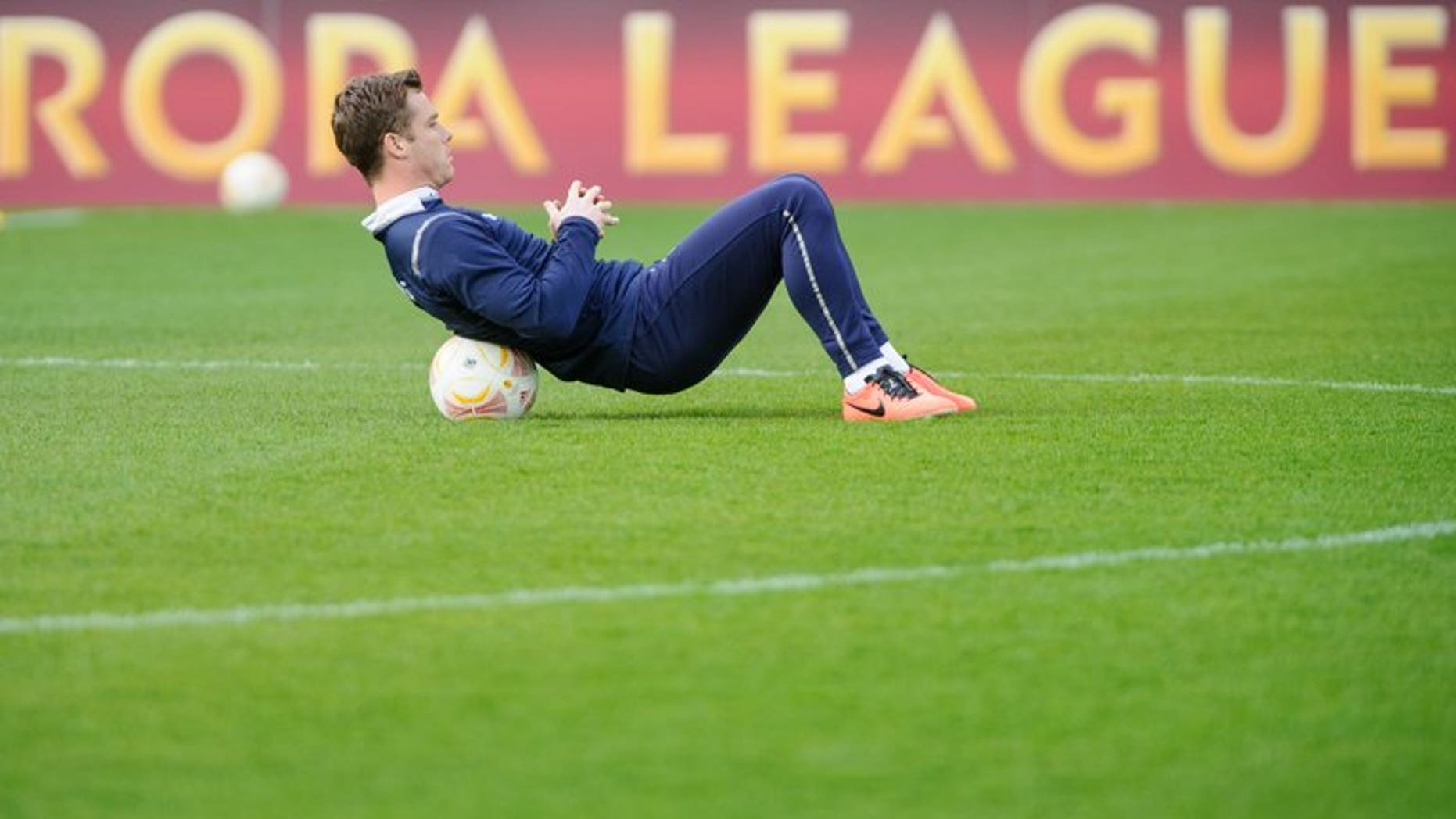 Scott Parker stretches during a training session at the Saint Jakok stadium in Basel on April 10, 2013. Fulham signed England midfielder Parker from Tottenham for an undisclosed fee on Monday.
