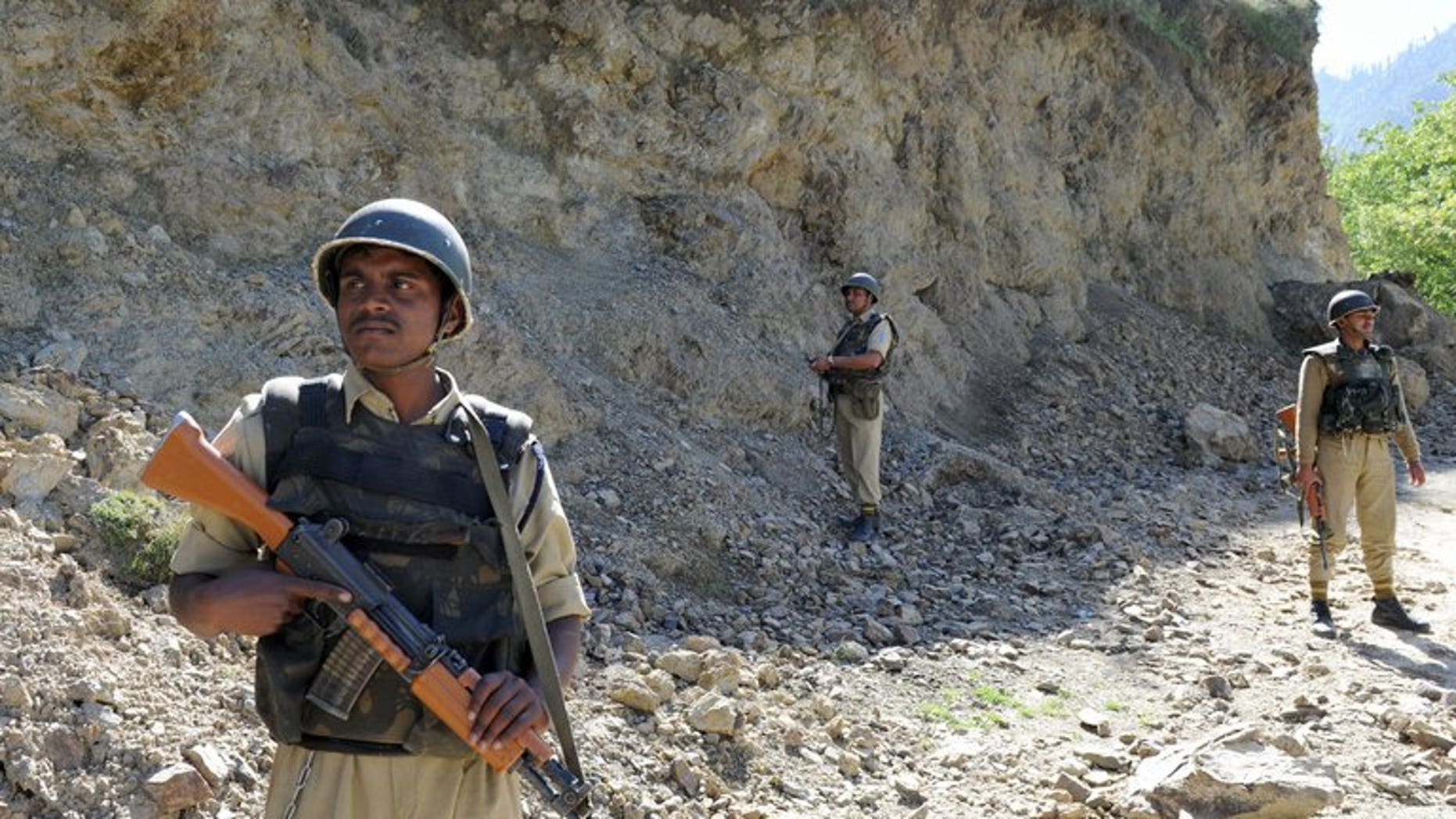 """Indian security forces stand guard near the Line of Control (LOC) on May 13, 2009. India's army will take """"all possible steps"""" to counter any ceasefire violations by Pakistan along the border between the countries, the Indian defence minister said Monday, warning not to take New Delhi's restraint for granted."""