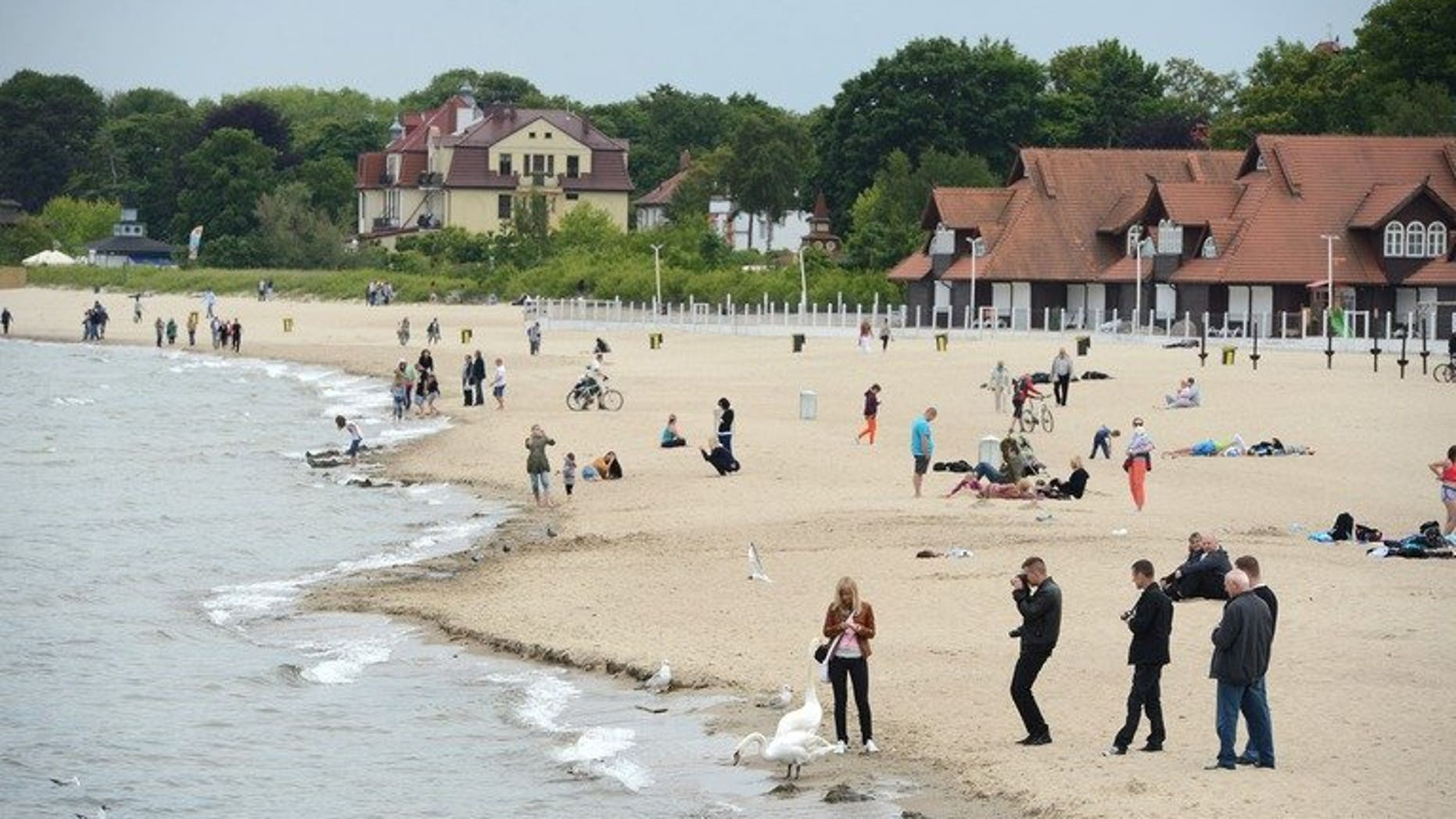 People relax on the beach on the Baltic Sea on June 7, 2012 in Sopot neer Gdansk. Mexico voiced concerns to Poland on Monday after a video surfaced of an alleged group of soccer hooligans mobbing Mexican navy cadets resting on a Polish beach.
