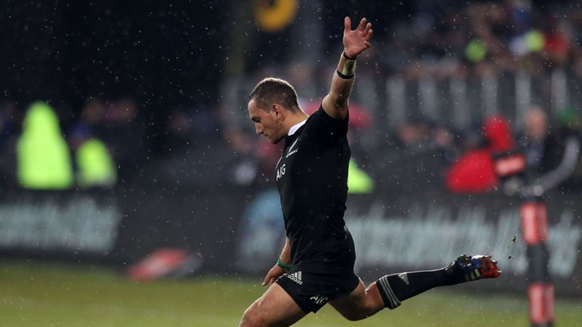 All Black Aaron Cruden of New Zealand, pictured kicking a penalty on June 15, 2013, will miss Saturday's clash with Australia. Also out are Beauden Barrett and Luke Romano.