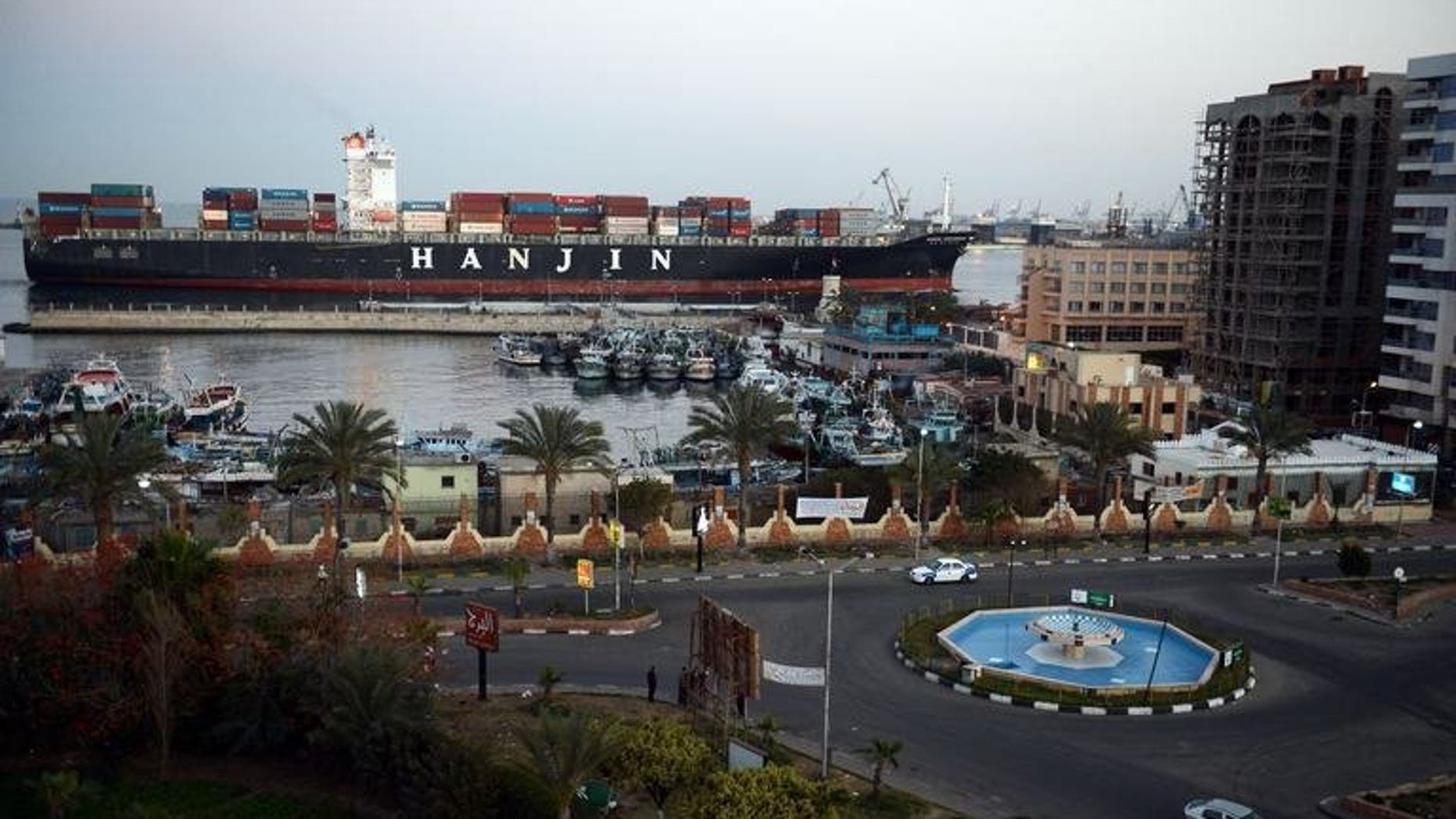 This file photo shows a container ship passing through the Suez Canal city of Port Said, on March 9, 2013. Gas-rich Qatar has dispatched a second shipment of free liquefied gas it had pledged to Egypt, a report said, despite Doha's criticism of Cairo's deadly crackdown on Muslim Brotherhood protesters.