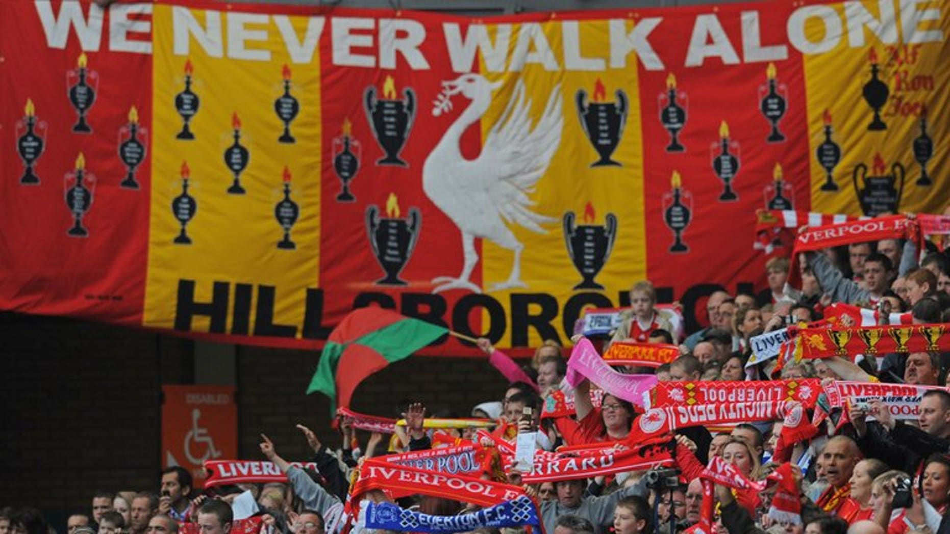 Liverpool supporters attend a Hillsborough memorial service 20 years after the disaster, at Anfield, on April 15, 2009. Police officers investigating the 1989 disaster wanted funds donated in memory of the victims to be spent on holiday flats and gifts for officers, British media reported.